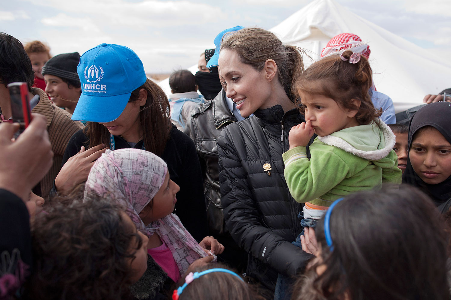 Angelina Jolie meets with refugees at the Zaatari refugee camp on Dec. 6, 2012 outside of Mafraq, Jordan.