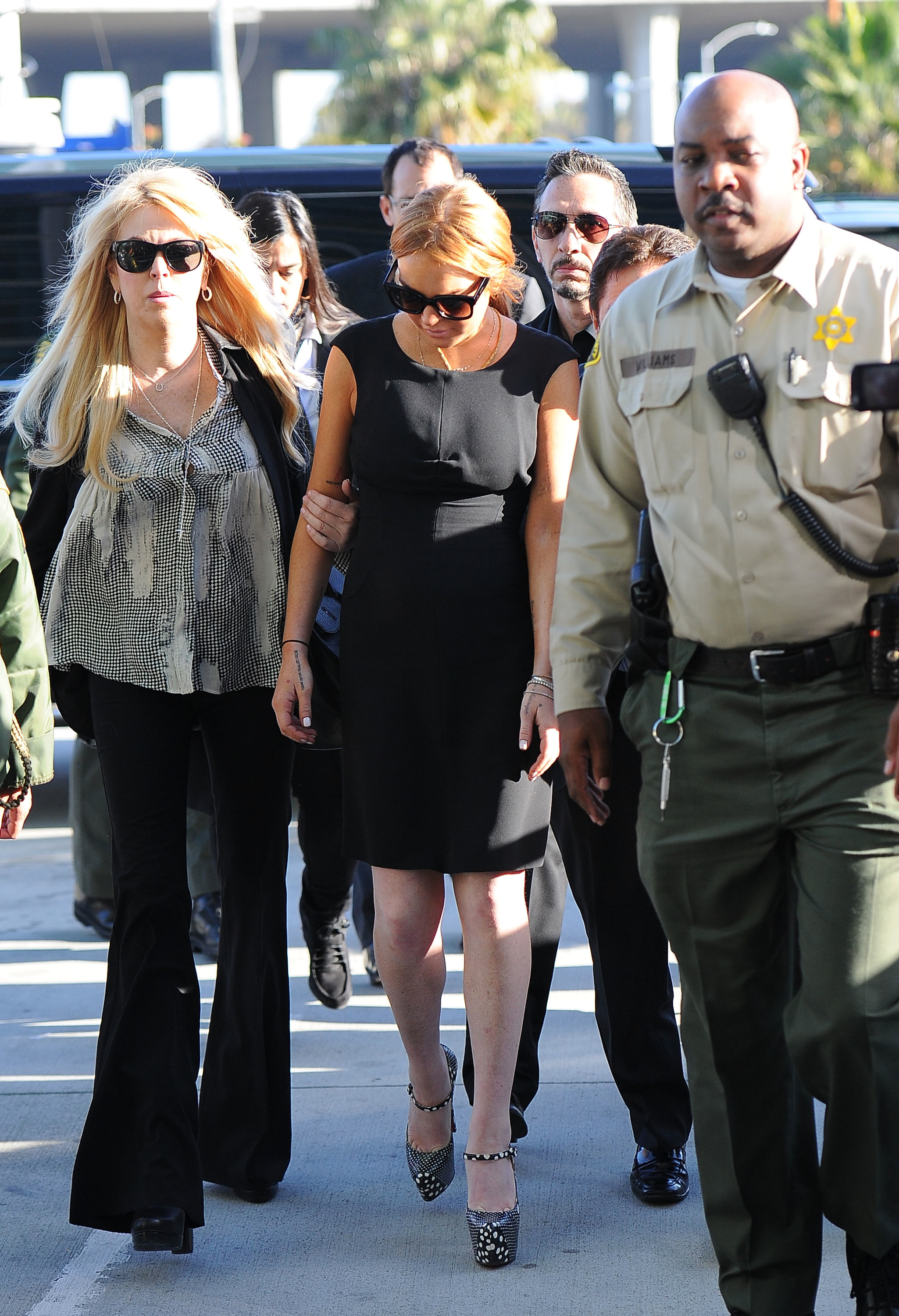 Lindsay Lohan is seen arriving at court with her mother, Dina, on January 30, 2013 in Los Angeles, California.