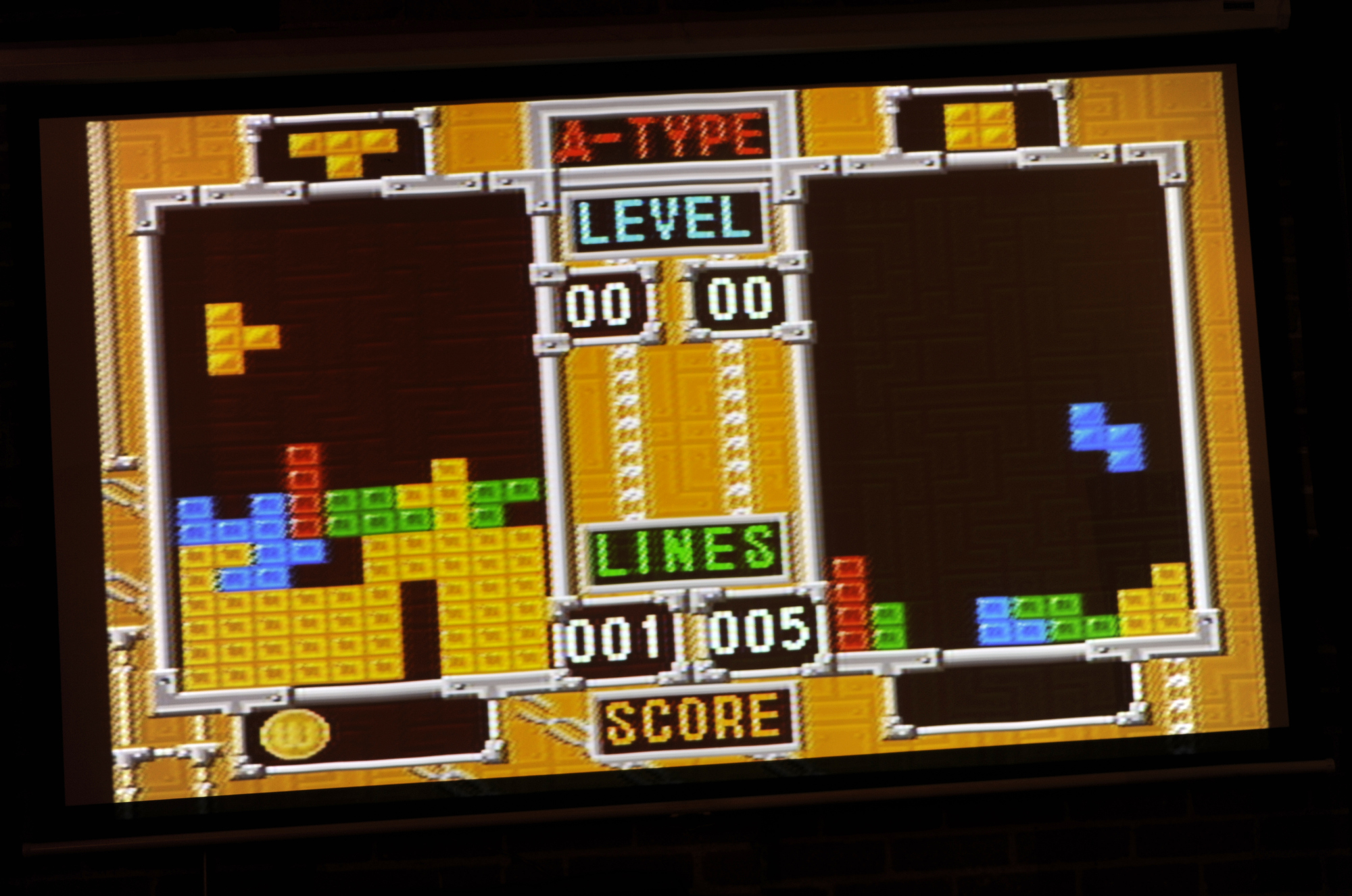 Tetris fanatics meet every month for intense head-to-head competititon in a double-elimination tournament format.