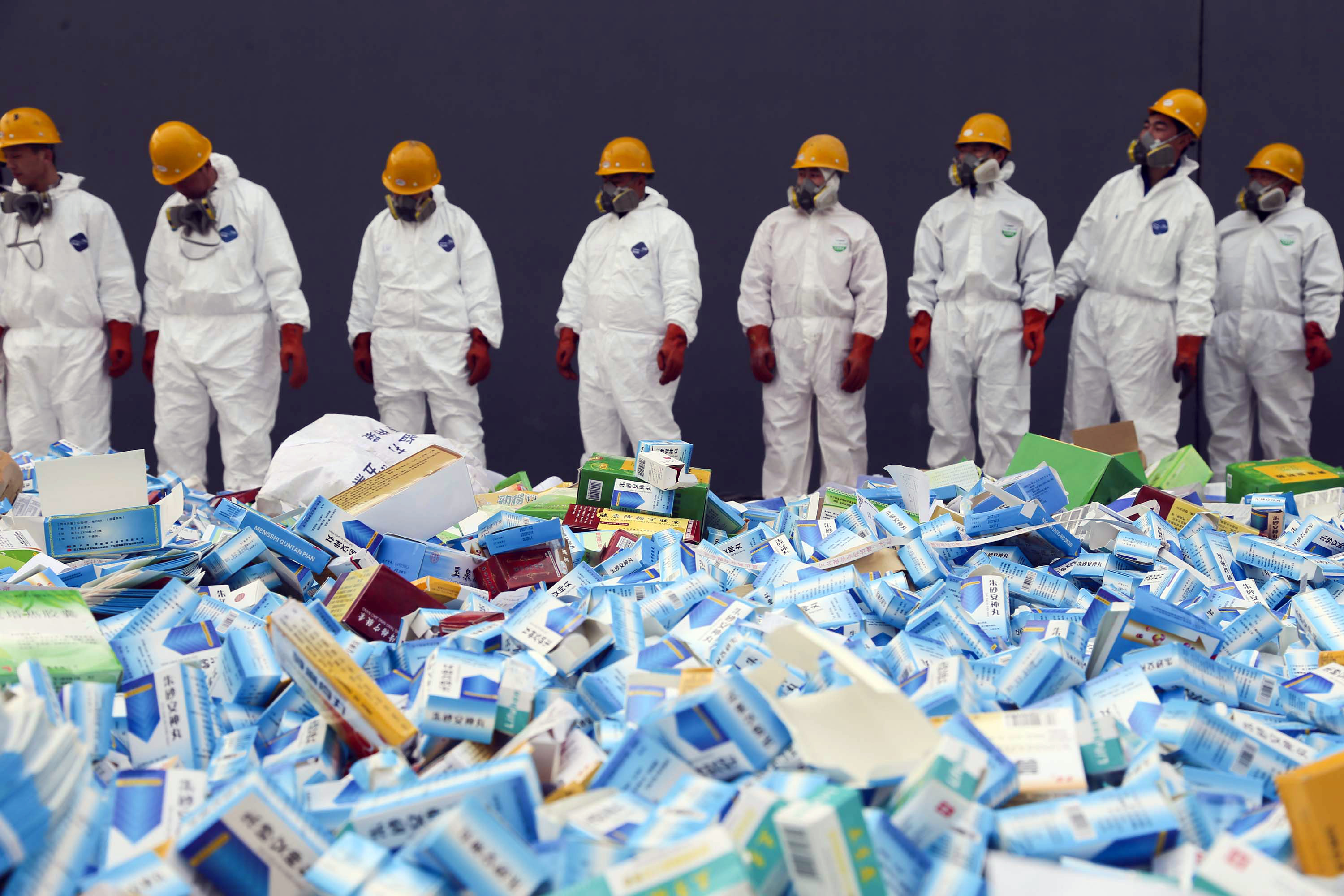 This picture taken on March 14 shows health workers preparing to destroy fake medicines seized in Beijing in recent months.