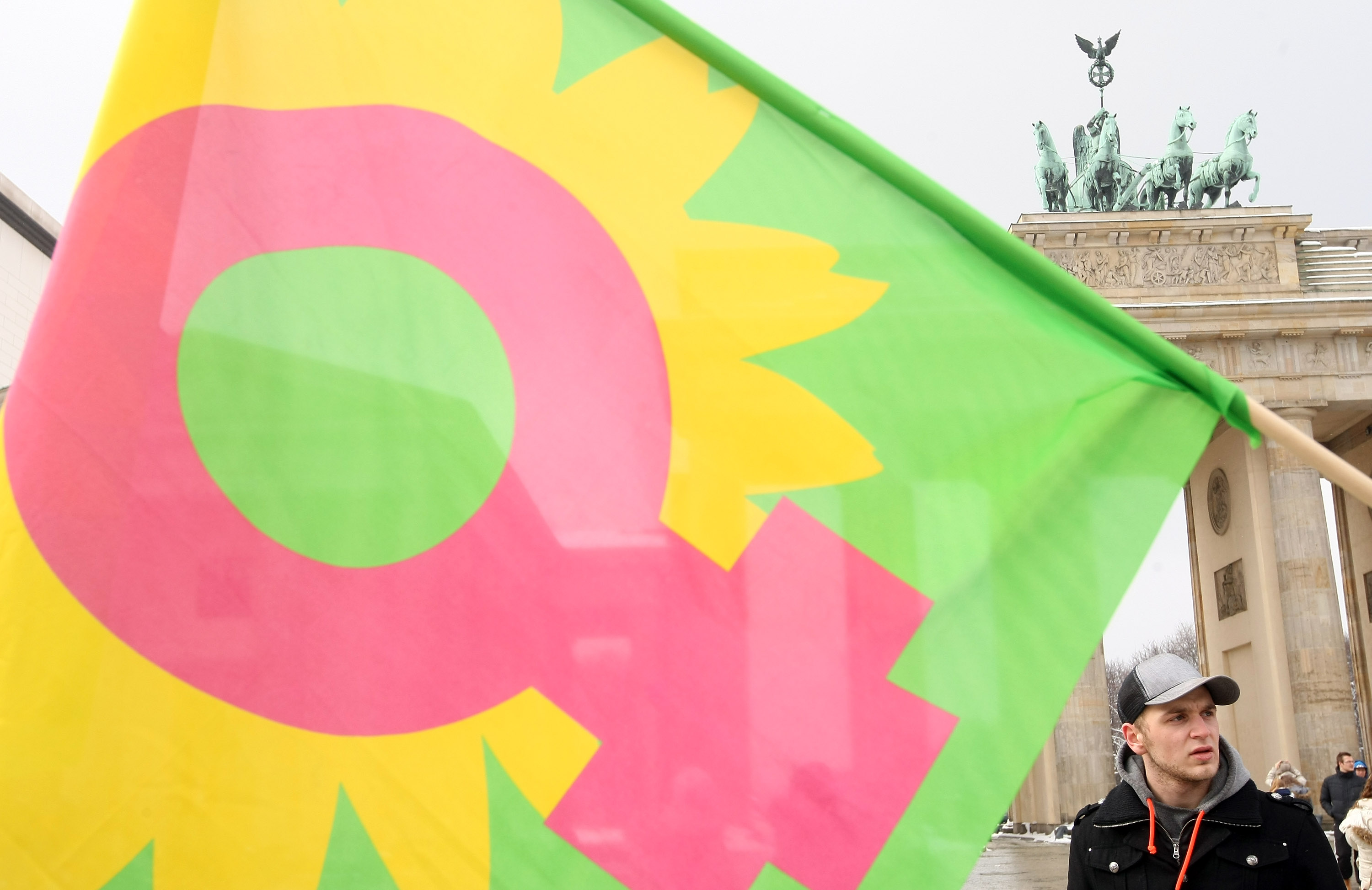 A flag with the female gender sign waves at an Equal Pay Day rally in front of the Brandenburg Gate on March 21, 2013 in Berlin, Germany.