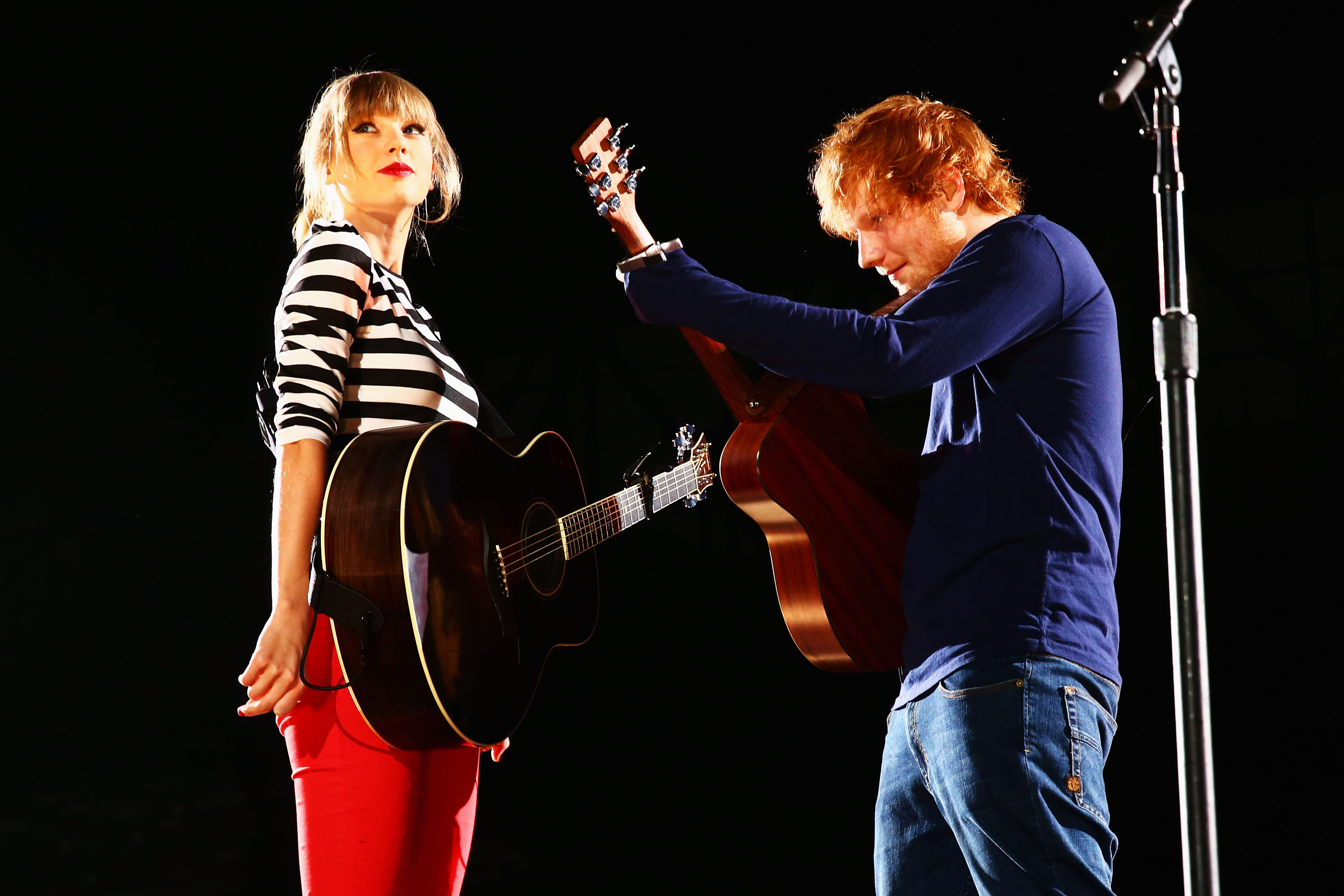 Taylor Swift and Ed Sheeran perform onstage at the first of 13 North American stadium dates on The RED Tour at Ford Field in front of a sold-out crowd of more than 48,000 fans on May 4, 2013 in Detroit, Michigan.