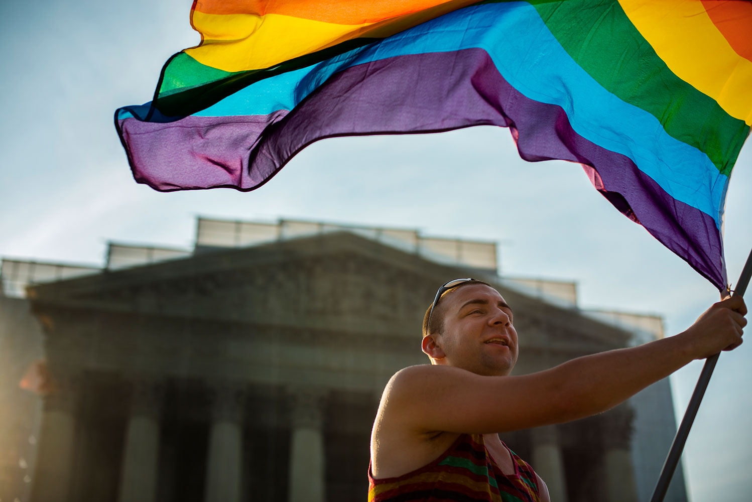 Same-sex-marriage supporters wave a rainbow flag in front of the U.S. Supreme Court in Washington, D.C., on June 26, 2013