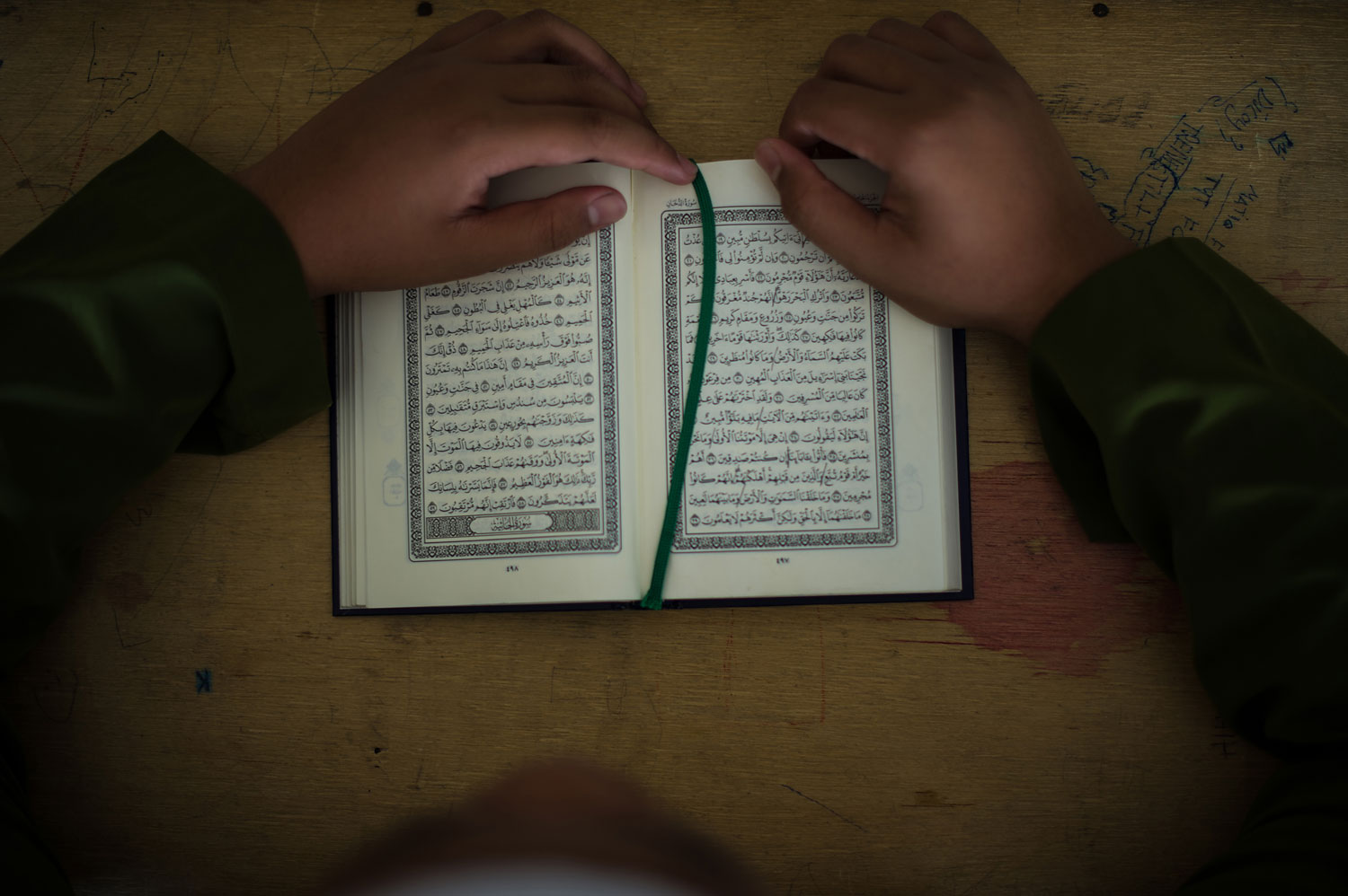A Muslim boy reads the Koran during the month of Ramadan, Kuala Lumpur, July 30, 2013.