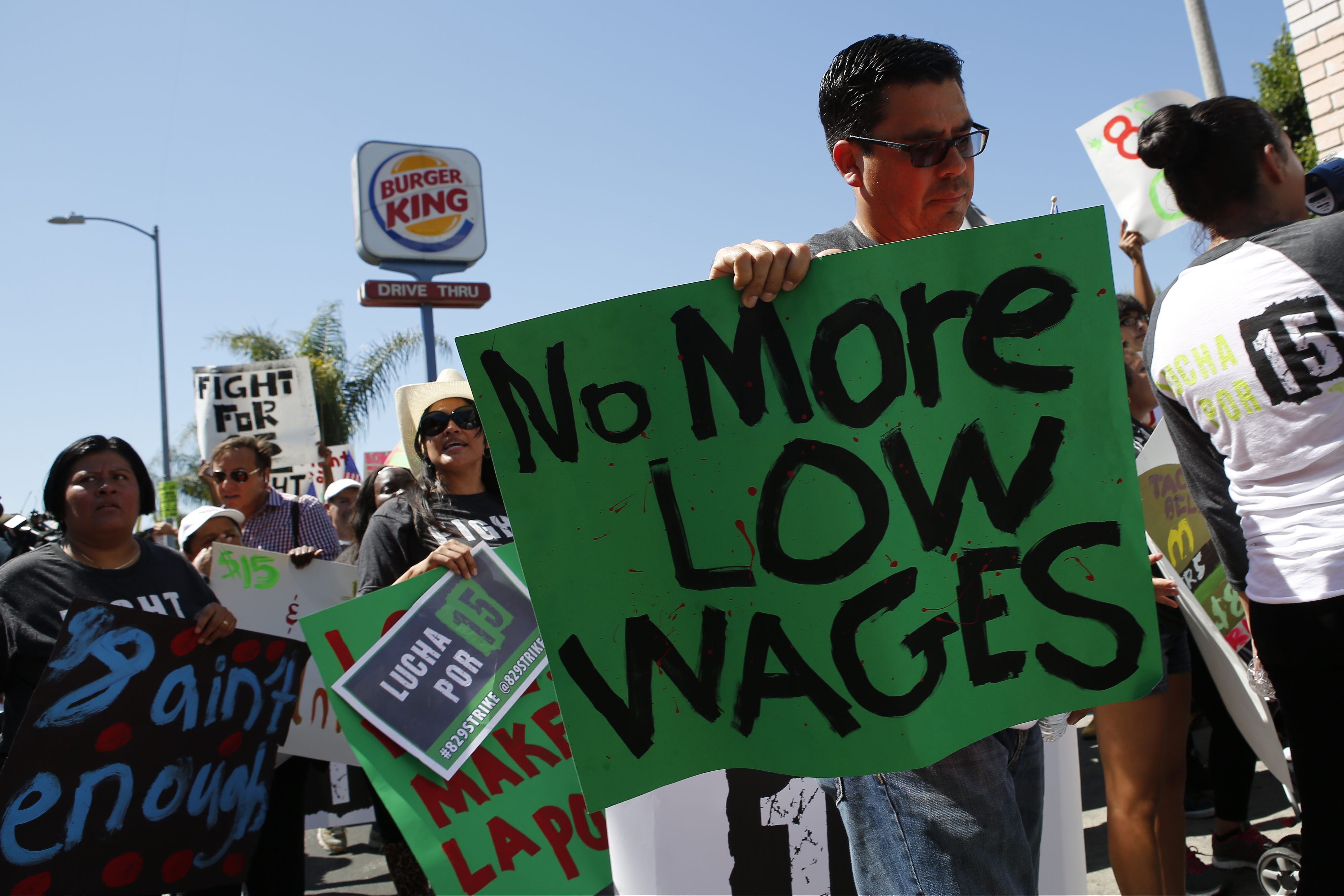 Fast-food workers and supporters organized by the Service Employees International Union (SEIU) protest outside of a Burger King Worldwide Inc. restaurant in Los Angeles, California, U.S., on Thursday, Aug. 29, 2013.