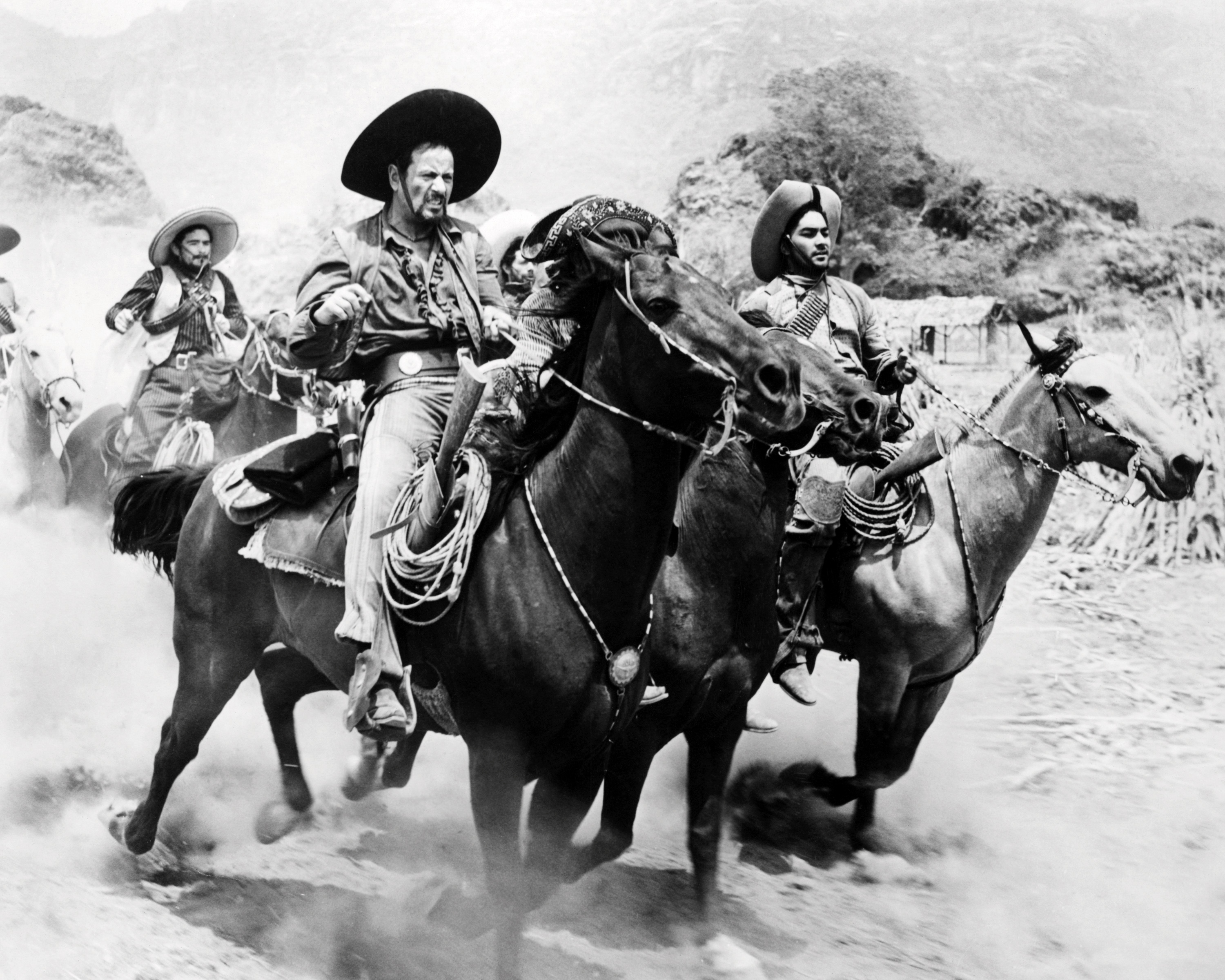 American actor Eli Wallach (foreground, left), as the bandit leader, Calvera, in 'The Magnificent Seven', directed by John Sturges, 1960. (Photo by Silver Screen Collection/Getty Images)