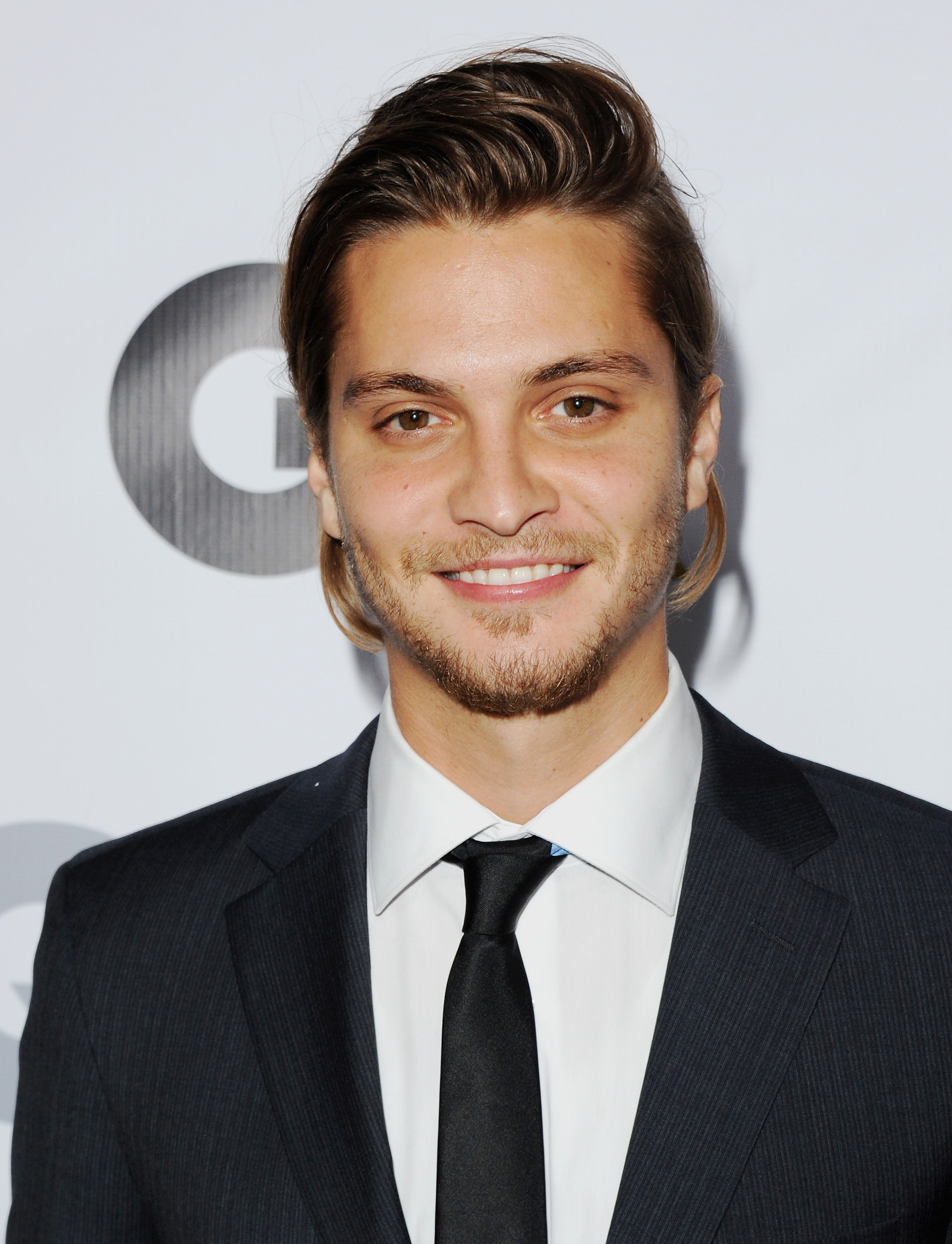 Actor Luke Grimes arrives at GQ Celebrates The 2013  Men Of The Year  at The Wilshire Ebell Theatre on November 12, 2013 in Los Angeles.