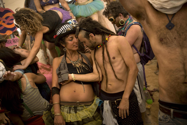 Israelis dance at a party during Israel''s first Midburn festival in the Negev Desert near the Israeli kibbutz of Sde Boker on  June 5, 2014., The midburn festival is modeled after the popular Burning Man festival held annually in the Black Rock Desert of Nevada,