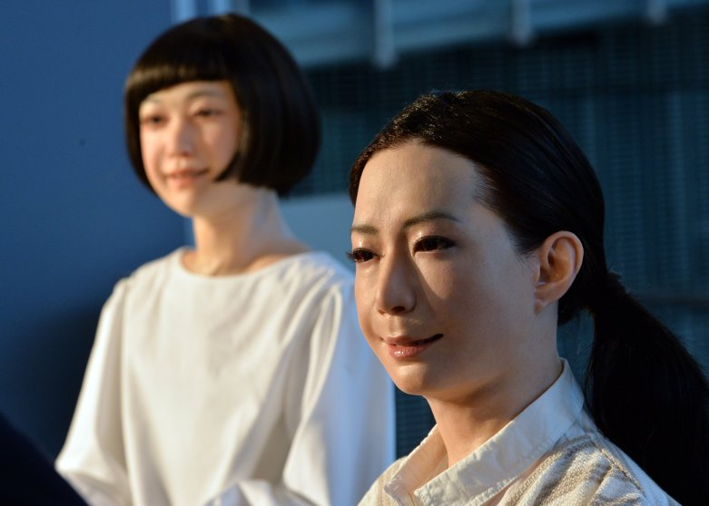 """The new humanoid robots named """"Otonaroid"""" and """"Kodomoroid"""" are pictured during a press preview at the National Museum of Emerging Science and Technology in Tokyo on June 24, 2014."""