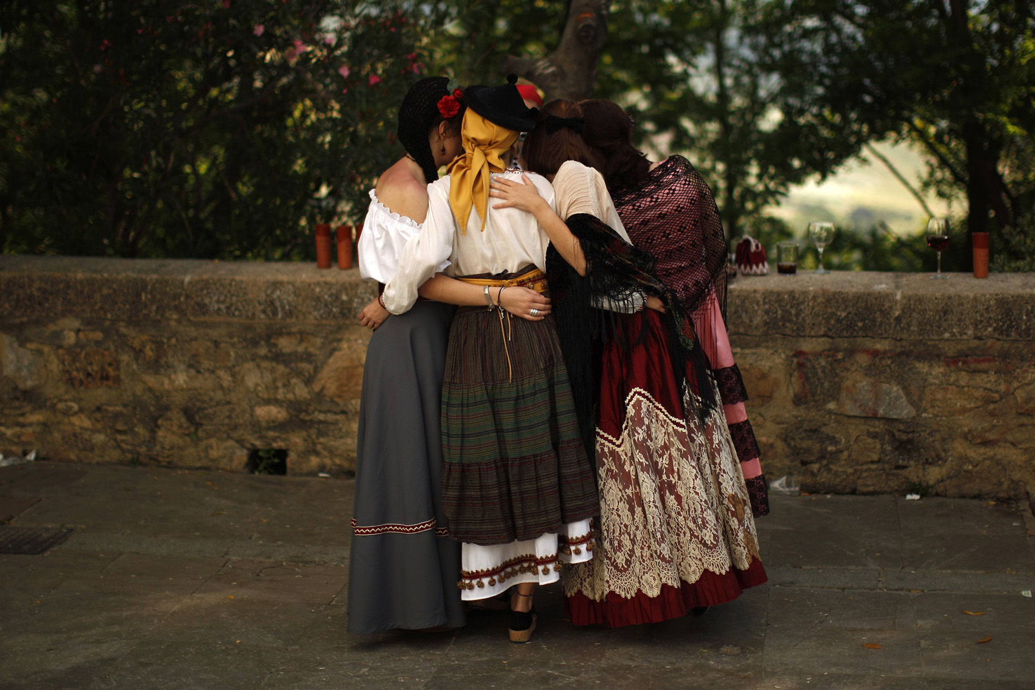 May 31, 2014. Women wearing traditional costumes are photographed by a friend during the second edition of  Ronda Romantica  (Romantic Ronda) in Ronda, near Malaga, southern Spain.