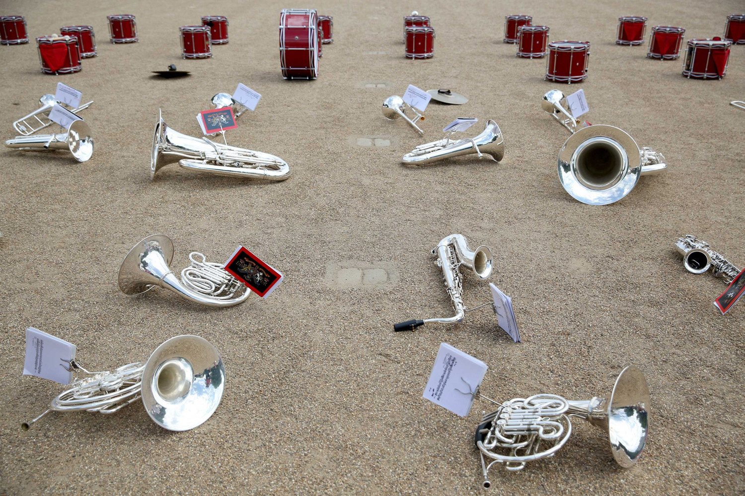 June 2, 2014. Instruments are left on the ground during a break as members of the Royal Marines Band rehearse for Beating Retreat on Horse Guards Parade in London.