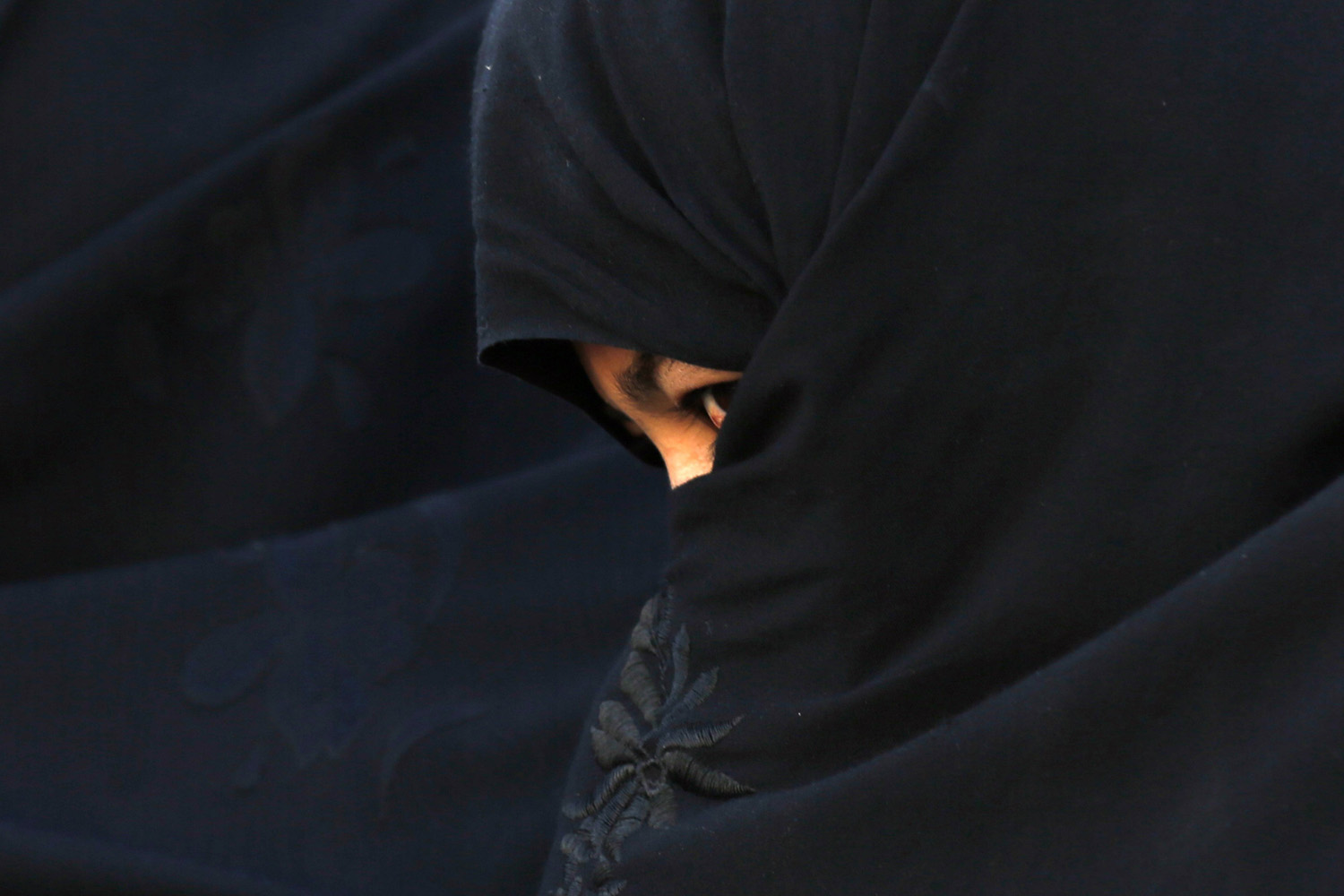 June 2, 2014. An Afghan woman attends an election campaign of Afghan presidential candidate Abdullah Abdullah in Chaghchran capital of Ghor province The second round presidential election will be held on June 14.