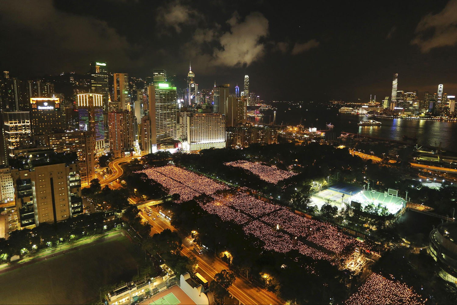 June 4, 2014. Tens of thousands of people participate in a candlelight vigil at Hong Kong's Victoria Park  to mark the 25th anniversary of the military crackdown of the pro-democracy movement at Beijing's Tiananmen Square in 1989.