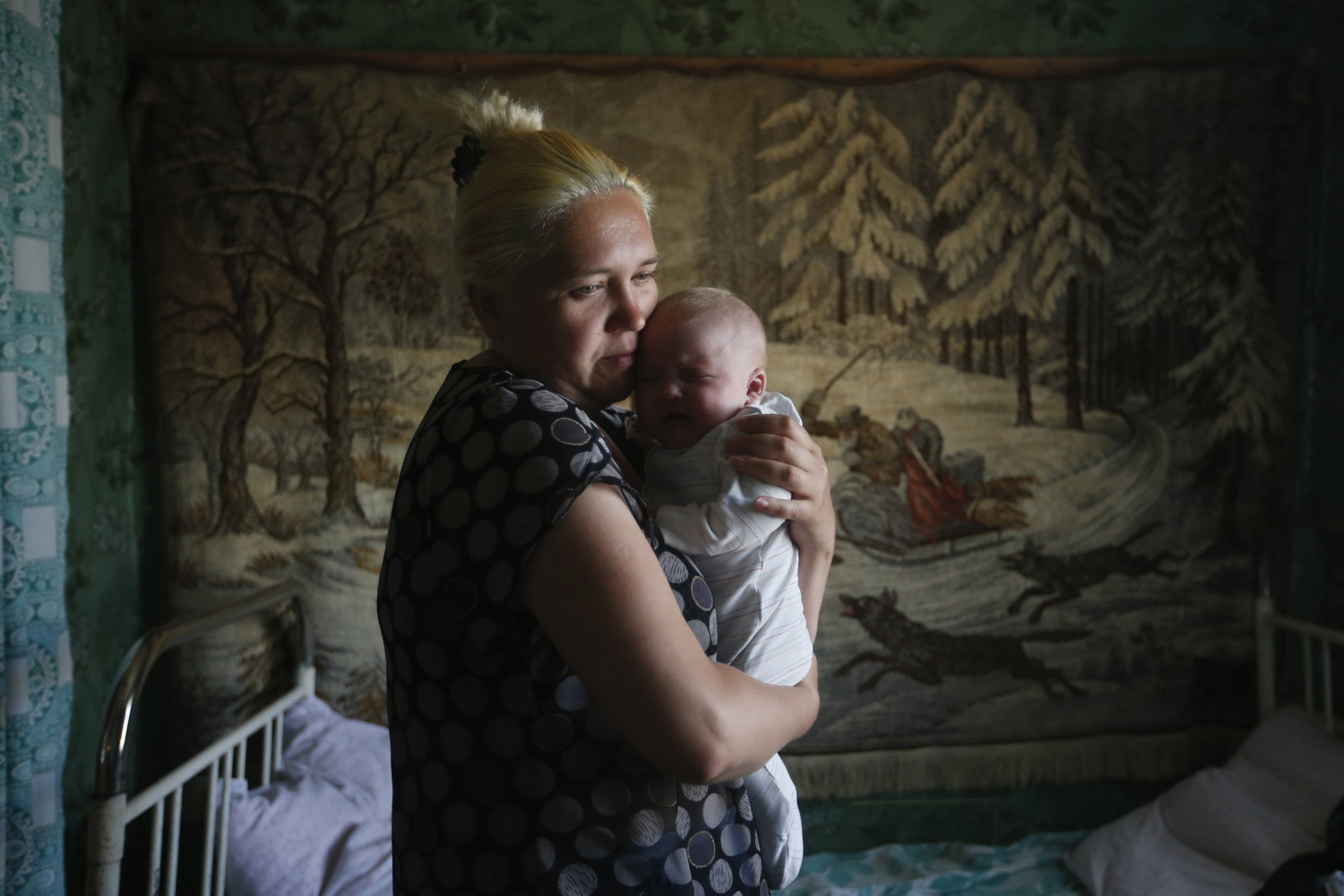 June 4, 2014. A mother and child who have fled from fighting in Slaviansk, stand in their temporary accommodation in the town of Nizhnaya Krinka in eastern Ukraine.