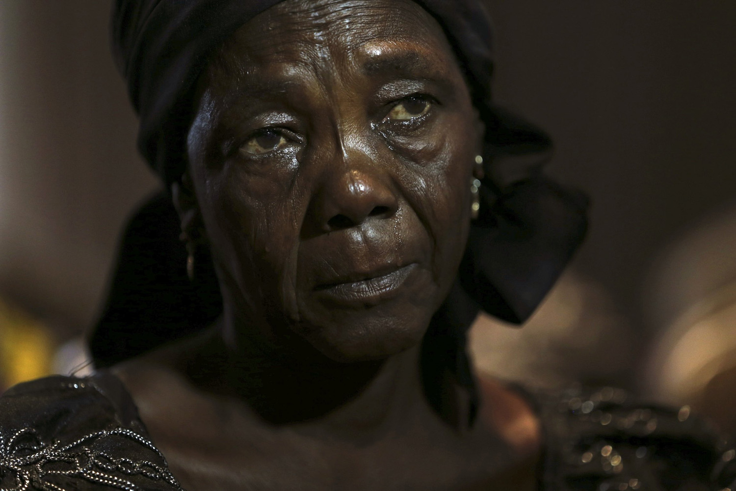 June 5, 2014. Hauwa Nkaki, mother of one of more than 200 girls abducted in the remote village of Chibok, cries as she reacts during a news conference on the girls in Lagos , Nigeria.