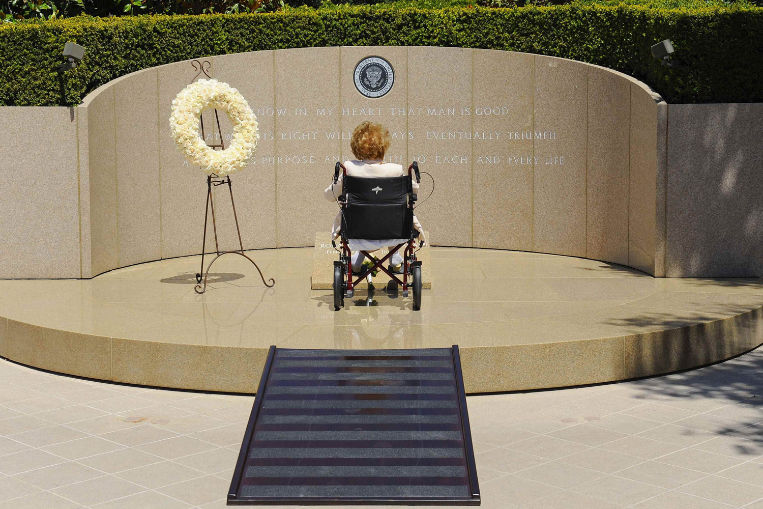 June 5, 2014. Former first lady of the United States Nancy Reagan visits the grave site of her husband, former United States President Ronald Wilson Reagan, at the Ronald Reagan Presidential Library on the 10th anniversary of his passing, in Simi Valley, California.