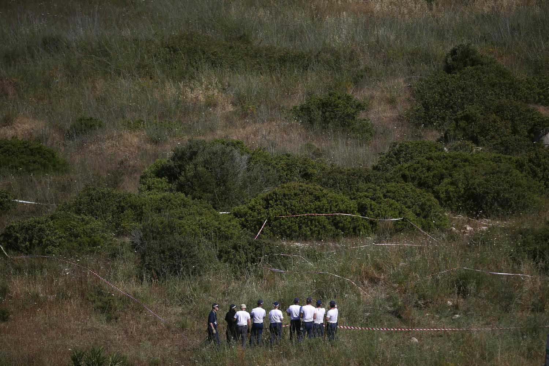 Jun. 11, 2014. Members of Scotland Yard work at an area during the search for missing British girl Madeleine McCann in Praia da Luz, near Lagos.
