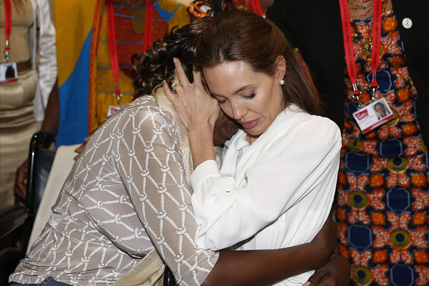 Jun. 11, 2014. Actress and Special Envoy of the United Nations High Commissioner for Refugees, Angelina Jolie, hugs Neema Namadamu of the Democratic Republic of Congo a the 'End Sexual Violence in Conflict' summit in London.