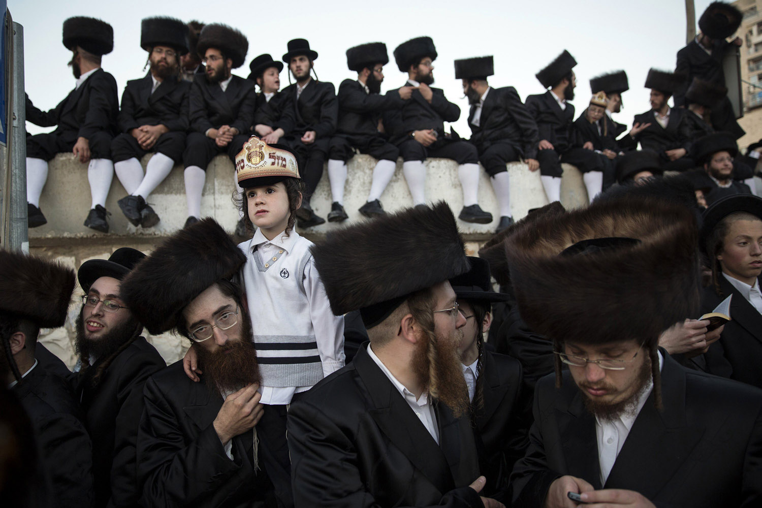 Jun. 10, 2014. Ultra-orthodox Jews watch the wedding ceremony of Esther Rokeach and Avraham Safrin (not pictured) in Jerusalem.