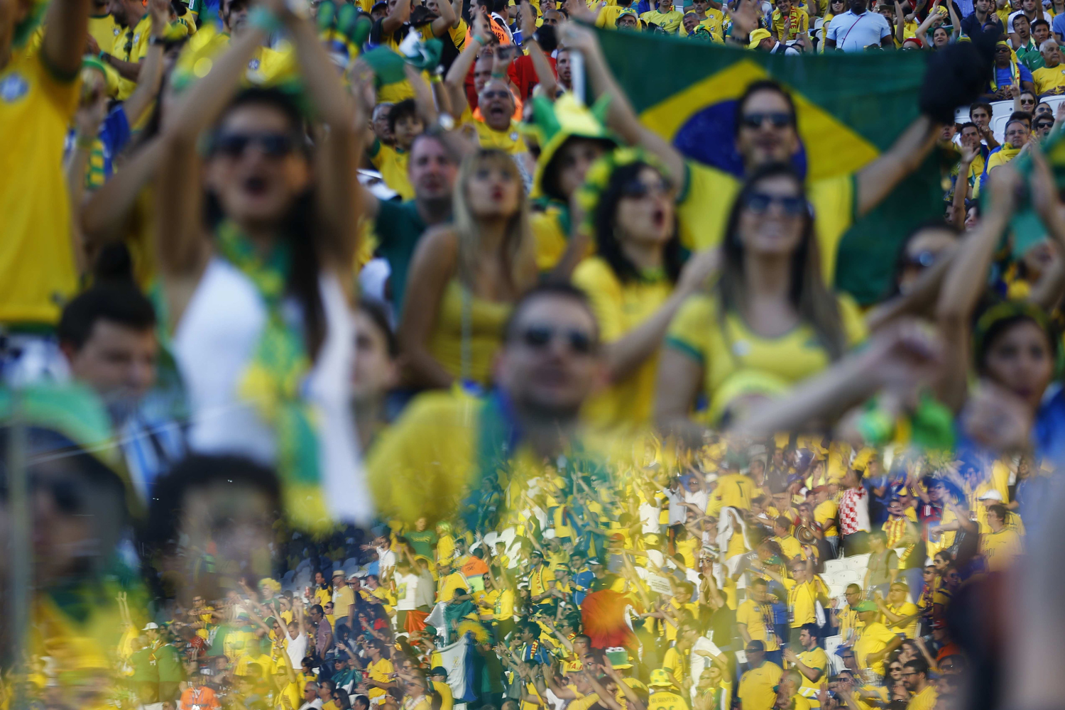 Jun. 12, 2014. A reflection of cheering fans is seen before the 2014 World Cup opening match between Brazil and Croatia at the Corinthians arena in Sao Paulo.