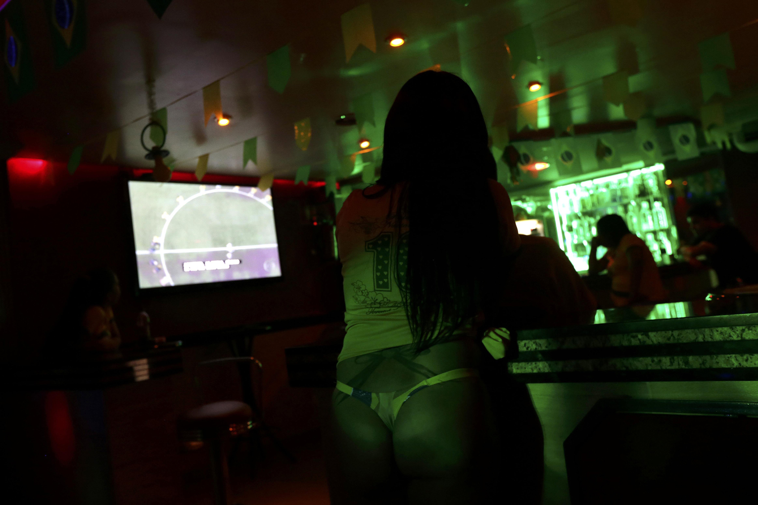 Jun. 12, 2014. A woman watches the 2014 World Cup match between Brazil and Croatia at a night club near the Corinthians Arena in Sao Paulo.