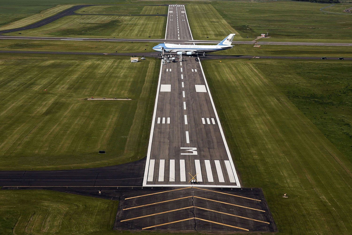 Jun. 13, 2014. Air Force One is seen from the air at Bismarck Municipal Airport in North Dakota.