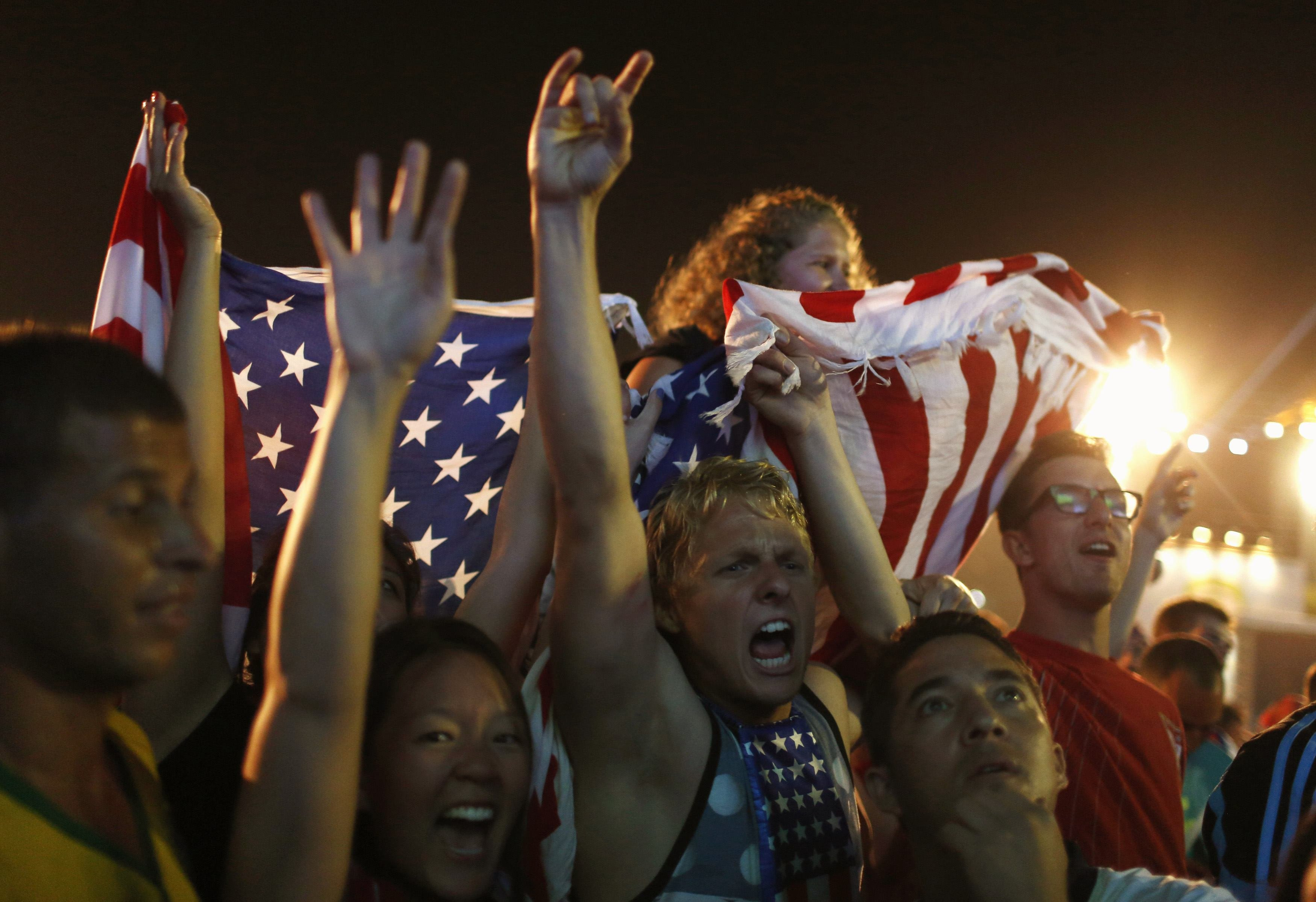 U.S. soccer fans celebrate at the end of the 2014 World Cup soccer match between U.S. and Ghana, in Rio de Janeiro on  June 16, 2014.