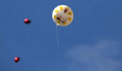A balloon with an image of Pope Francis flies during a weekly general audience leads by the pope at St. Peter's Square at the Vatican