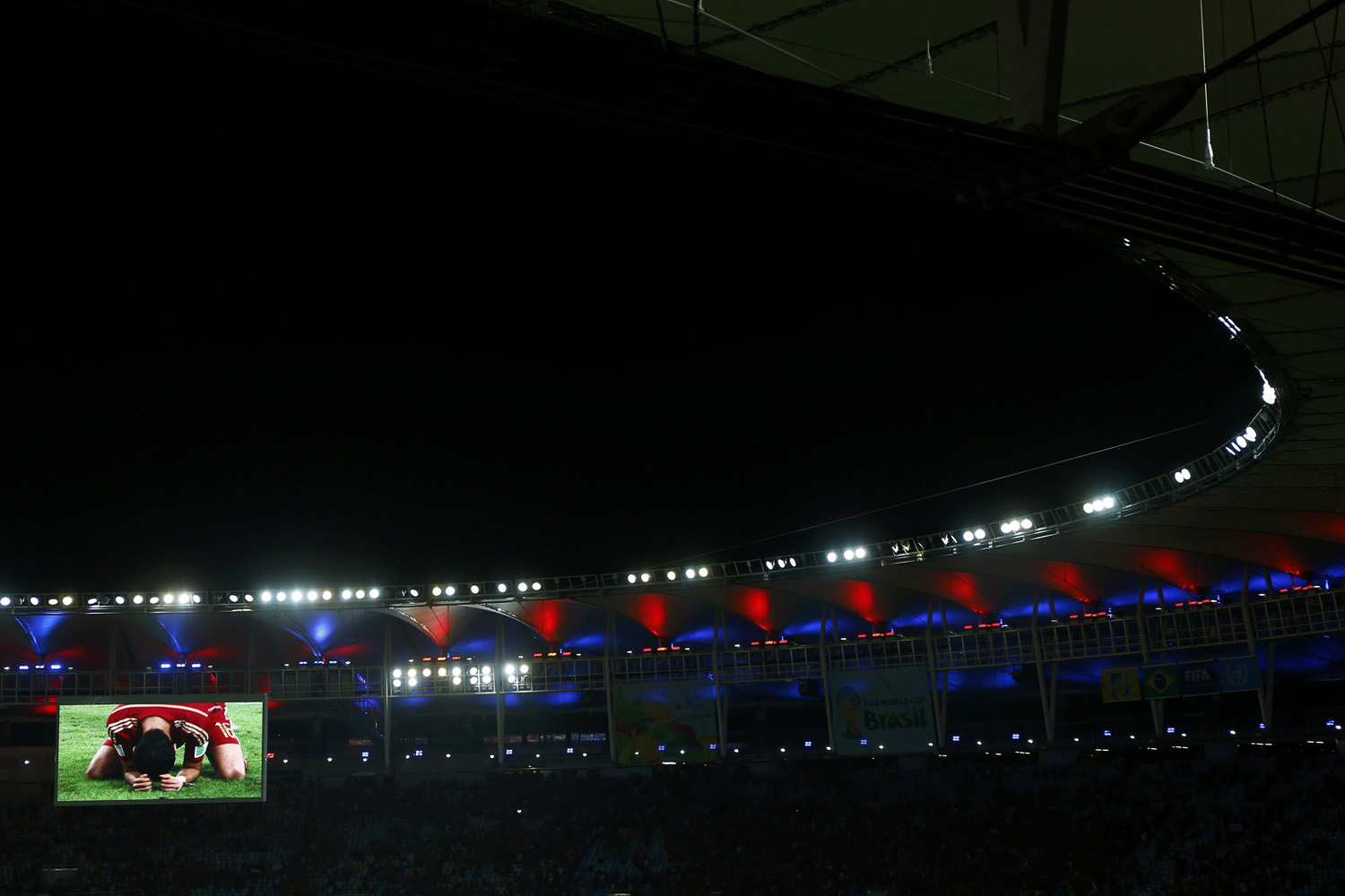 Jun. 18, 2014. Match highlights are screened after the 2014 World Cup Group B soccer match between Spain and Chile at the Maracana stadium in Rio de Janeiro.