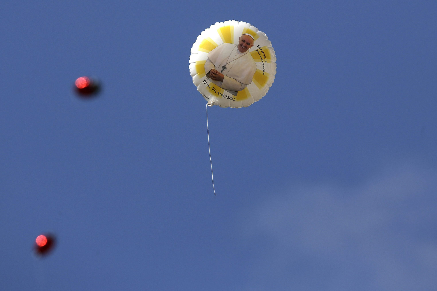 Jun. 18, 2014. A balloon with an image of Pope Francis flies during a weekly general audience leads by the pope at St. Peter's Square at the Vatican.
