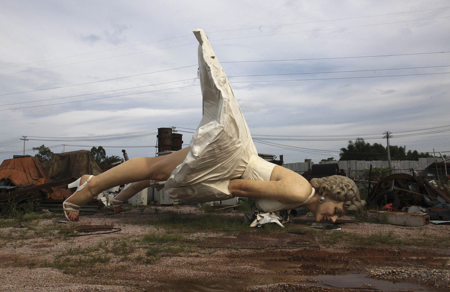 A giant statue of U.S. actress Marilyn Monroe is seen at the dump site of a garbage collecting company in Guigang, Guangxi Zhuang Autonomous Region on June 18, 2014.