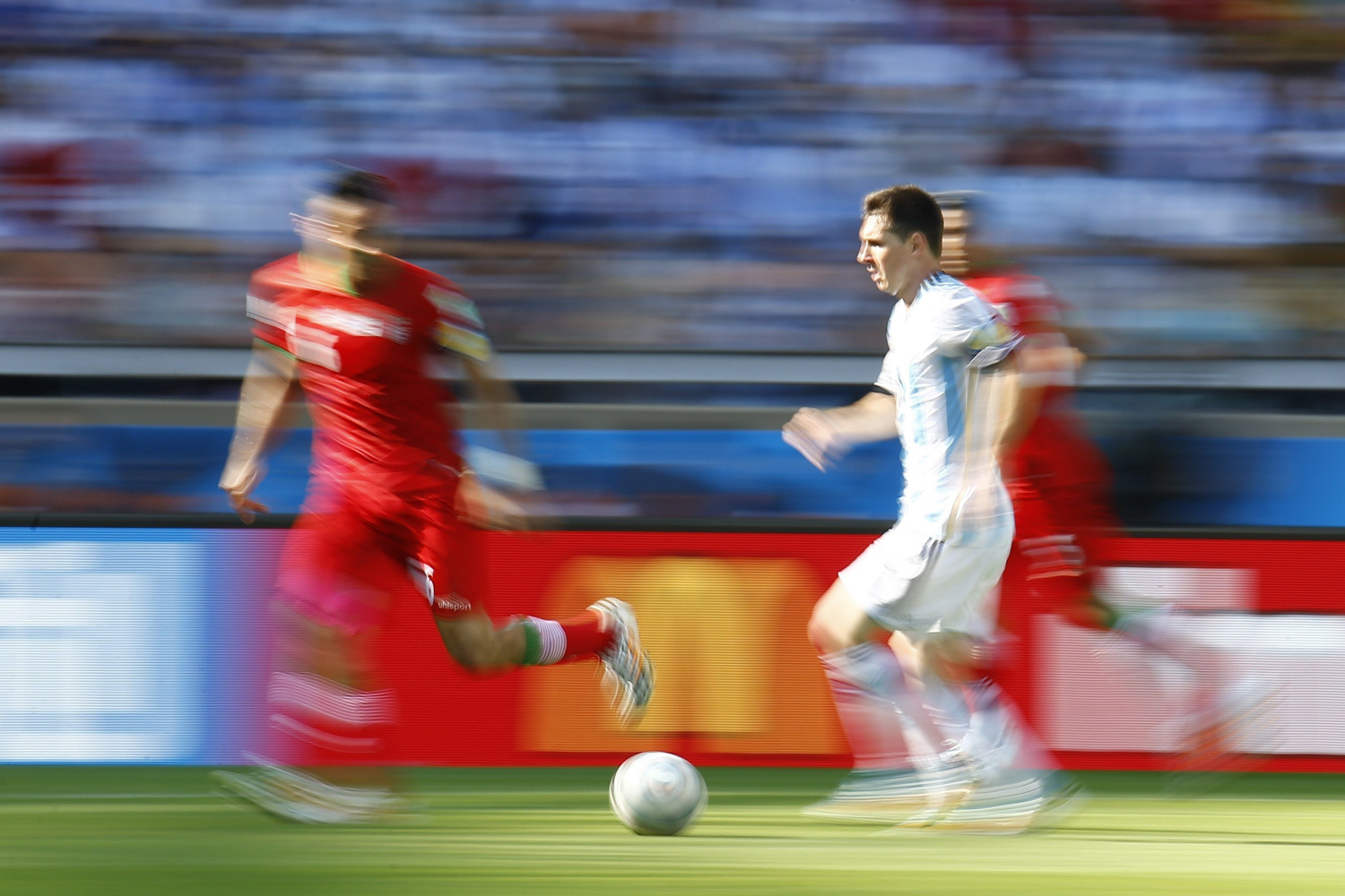 Jun. 21, 2014.  Argentina's Lionel Messi fights for the ball with Iran's Javad Nekounam (L) during their 2014 World Cup Group F soccer match at the Mineirao stadium in Belo Horizonte, Brazil.