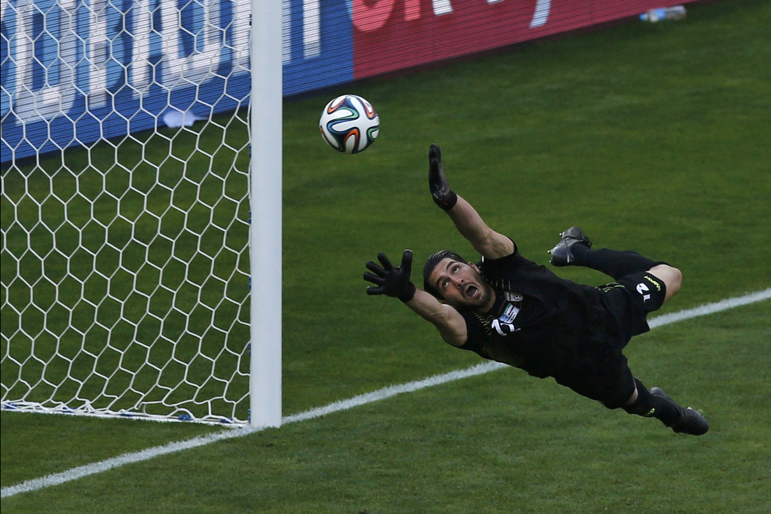 Jun. 21, 2014. Iran's goalkeeper Alireza Haghighi fails to save a goal by Argentina's Lionel Messi (unseen) during their 2014 World Cup Group F soccer match at the Mineirao stadium in Belo Horizonte, Brazil.