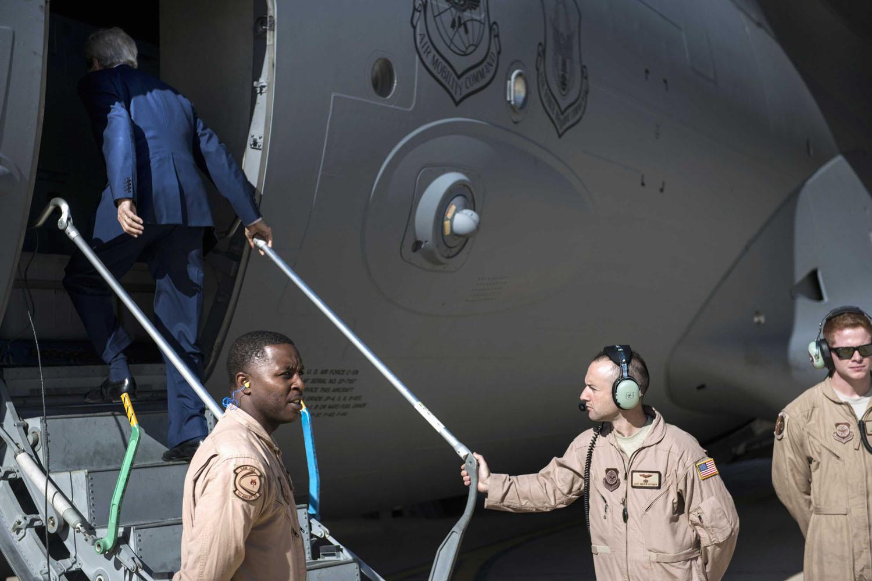 Jun. 23, 2014. U.S. Secretary of State John Kerry (L) boards a plane at Jordan's Queen Alia International Airport in Amman, as he travels to Iraq.