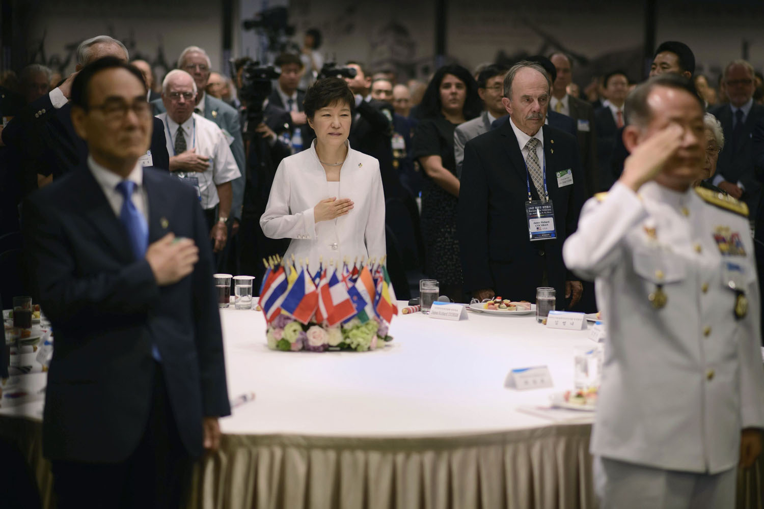 Jun. 24, 2014. South Korea's President Park Geun-hye (C) listens to the national anthem as she attends a  Korean War Veterans Commeroration Ceremony  in Seoul.