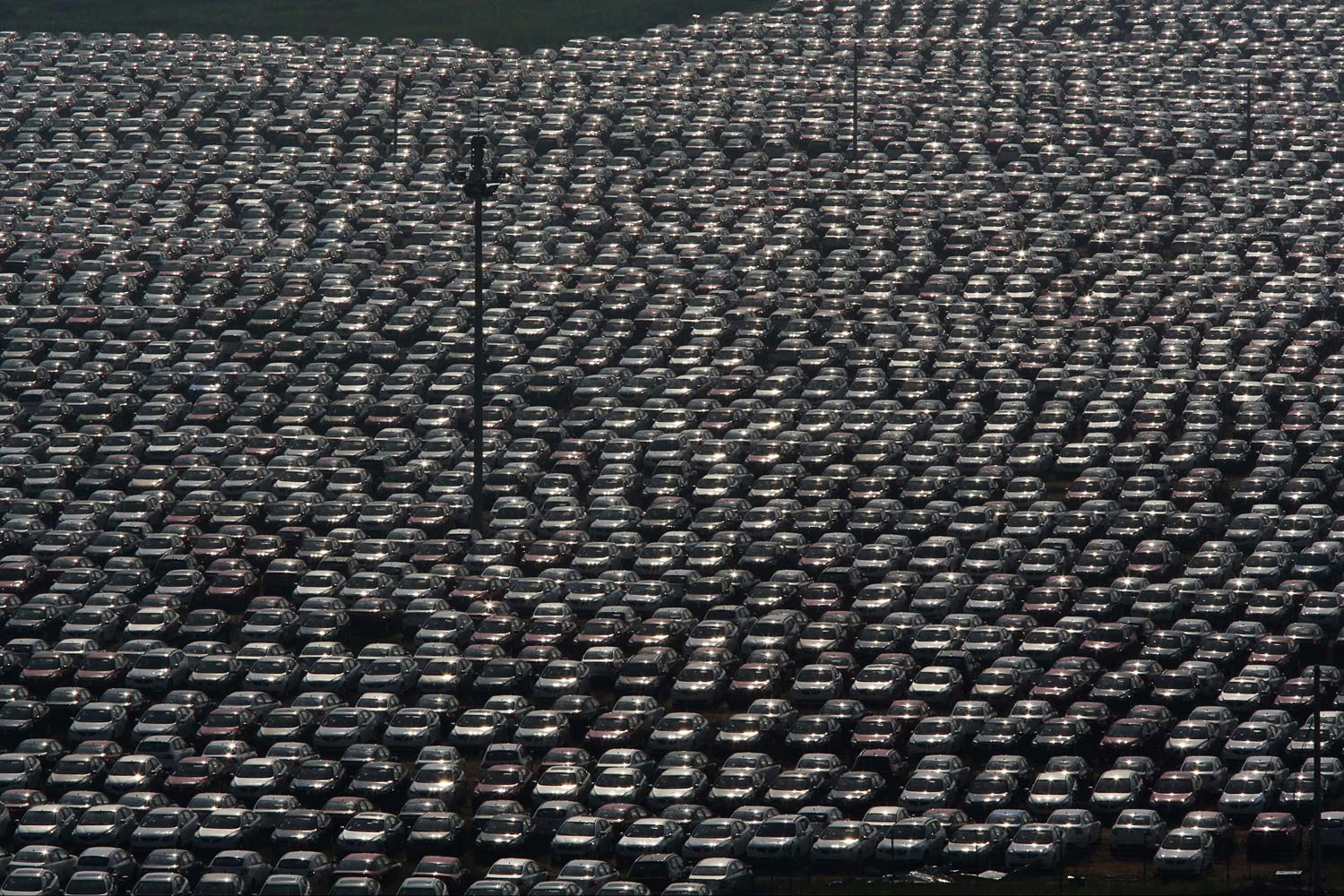Jun. 24, 2014. New vehicles park at a Chinese automobile factory in Shenyang, Liaoning province.