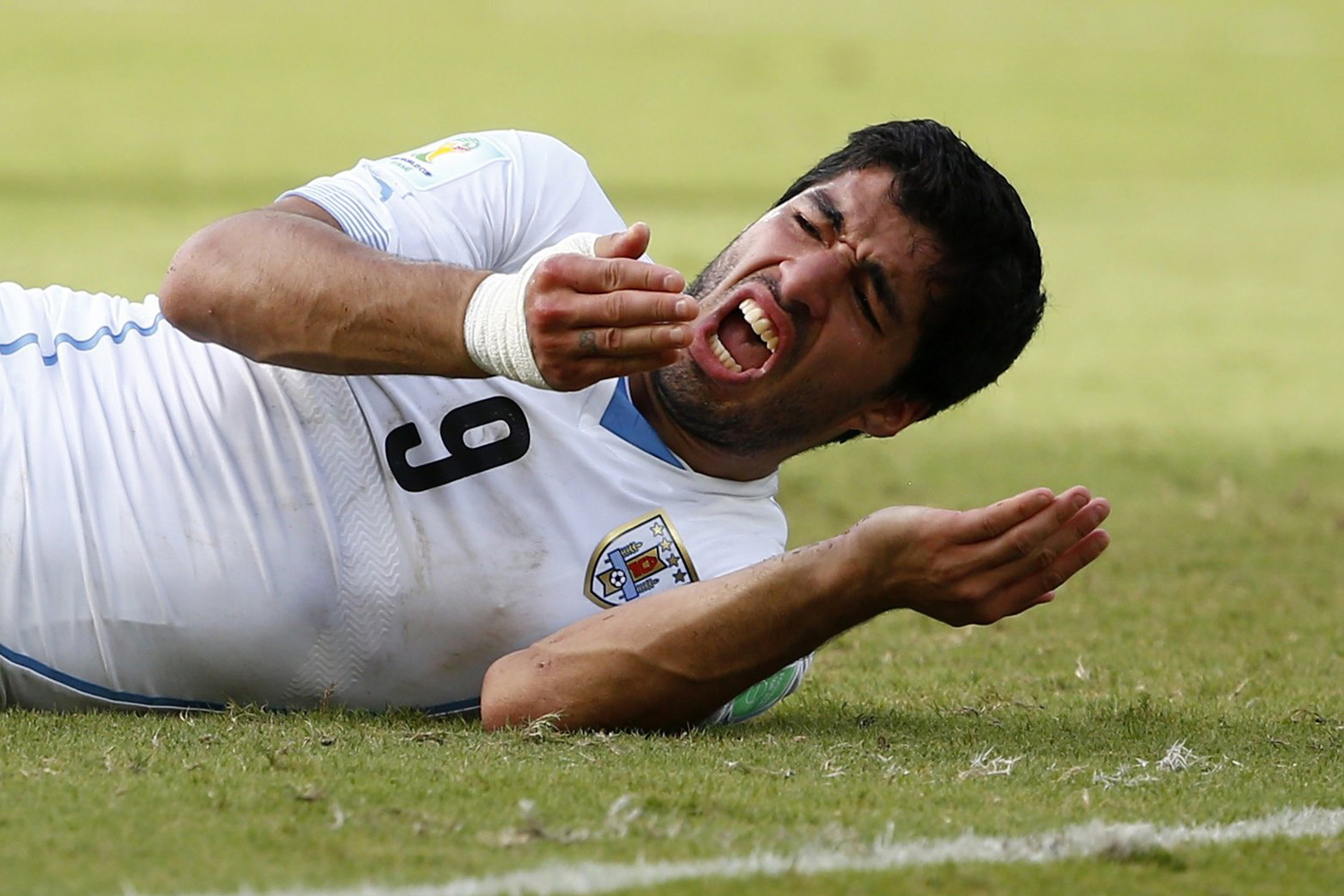 June 24, 2014. Uruguay's Luis Suarez reacts after clashing with Italy's Giorgio Chiellini during their 2014 World Cup Group D soccer match at the Dunas arena in Natal, Brazil.