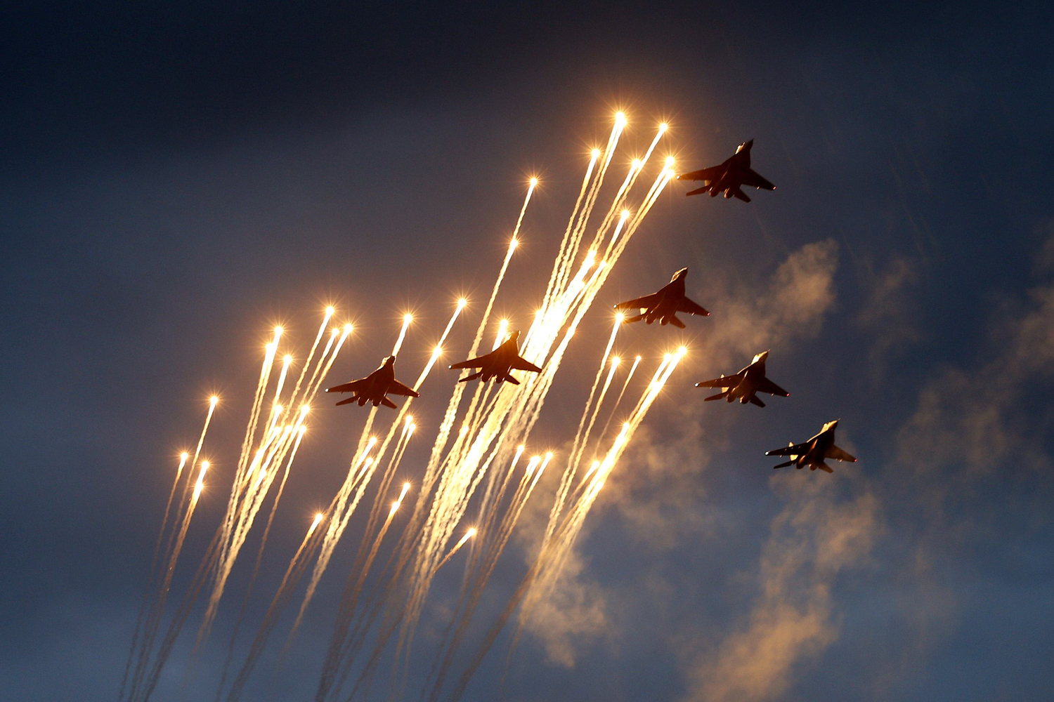 Jun. 26, 2014. Belarussian MiG-29 jet fighters take part in a rehearsal for a military parade in Minsk.