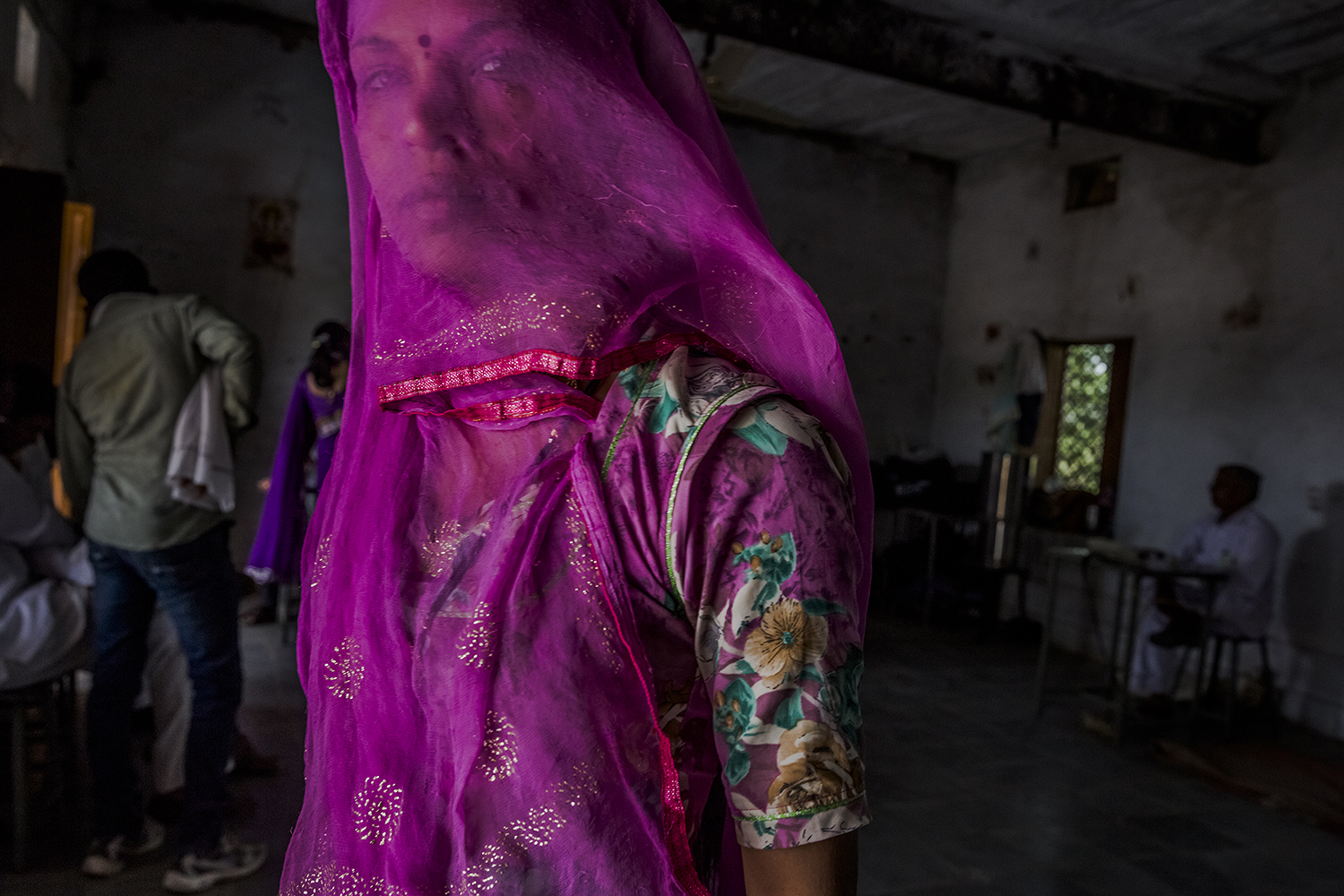 Indian women wait to cast their vote at a polling station on April 17, 2014 in the Jodhpur District in the desert state of Rajasthan, India.