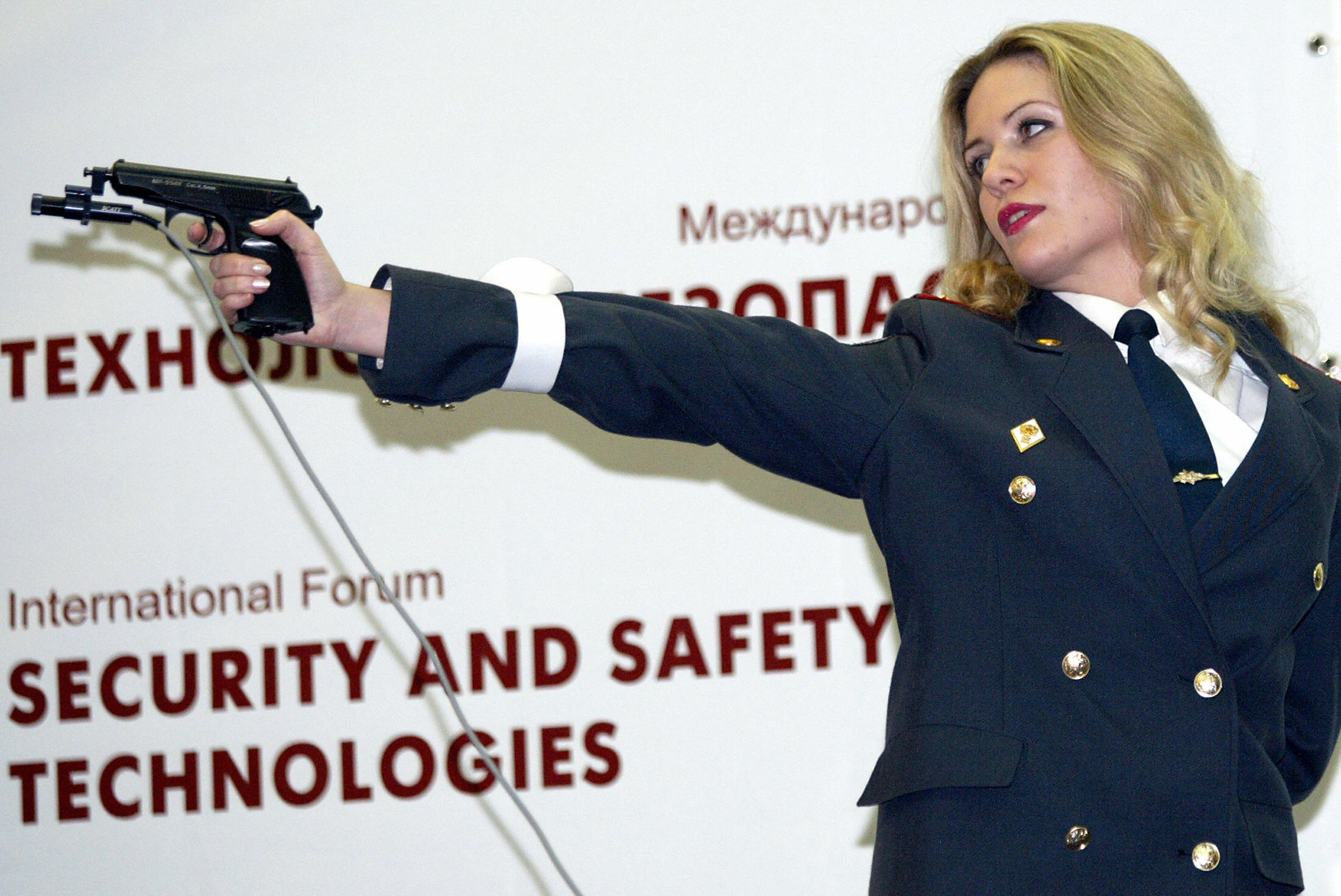A Russian policewoman shoots during a  Miss Security  contest in Moscow, 2004.  Russian policewomen bared their legs, navels and a bit of cleavage as they competed to become Moscow's first Miss Security.