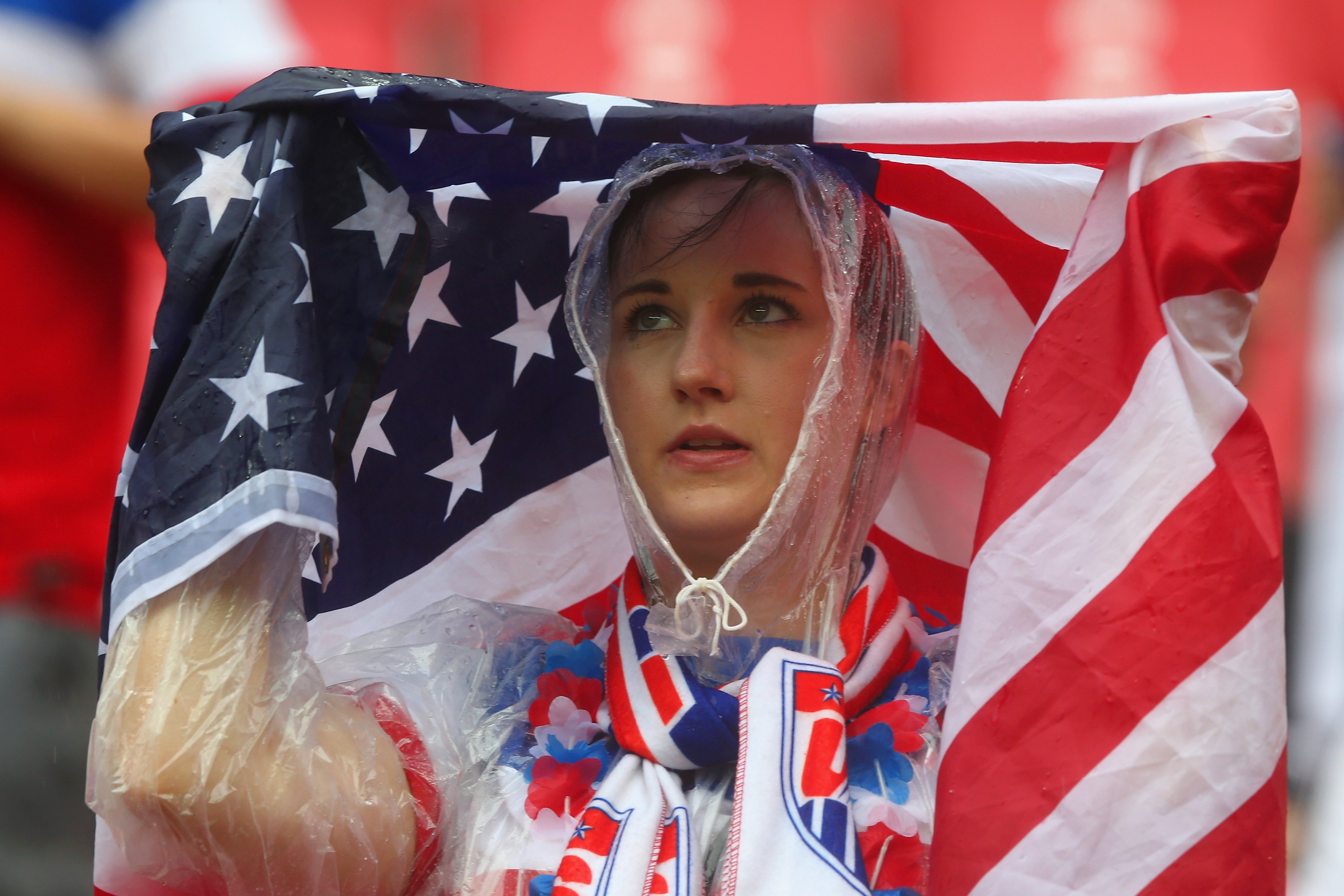 An United States fan looks on in the rain prior to the 2014 FIFA World Cup Brazil group G match between the United States and Germany at Arena Pernambuco on June 26, 2014 in Recife, Brazil.