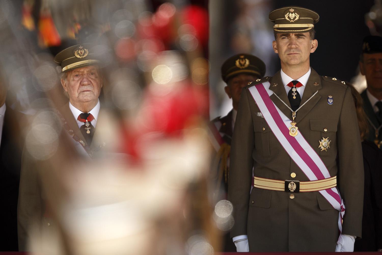June 3, 2014. King Juan Carlos and Crown Prince Felipe, right, attend a military ceremony in San Lorenzo de El Escorial, outside Madrid, Spain.