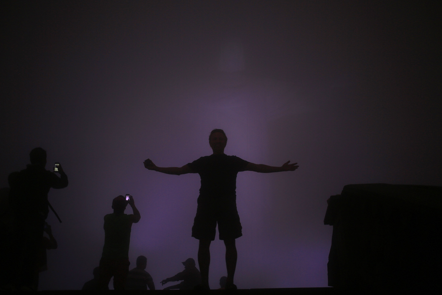 Jun. 11, 2014. Tourists stand below the Christ the Redeemer statue while it is covered by heavy fog, in Rio de Janeiro, Brazil.
