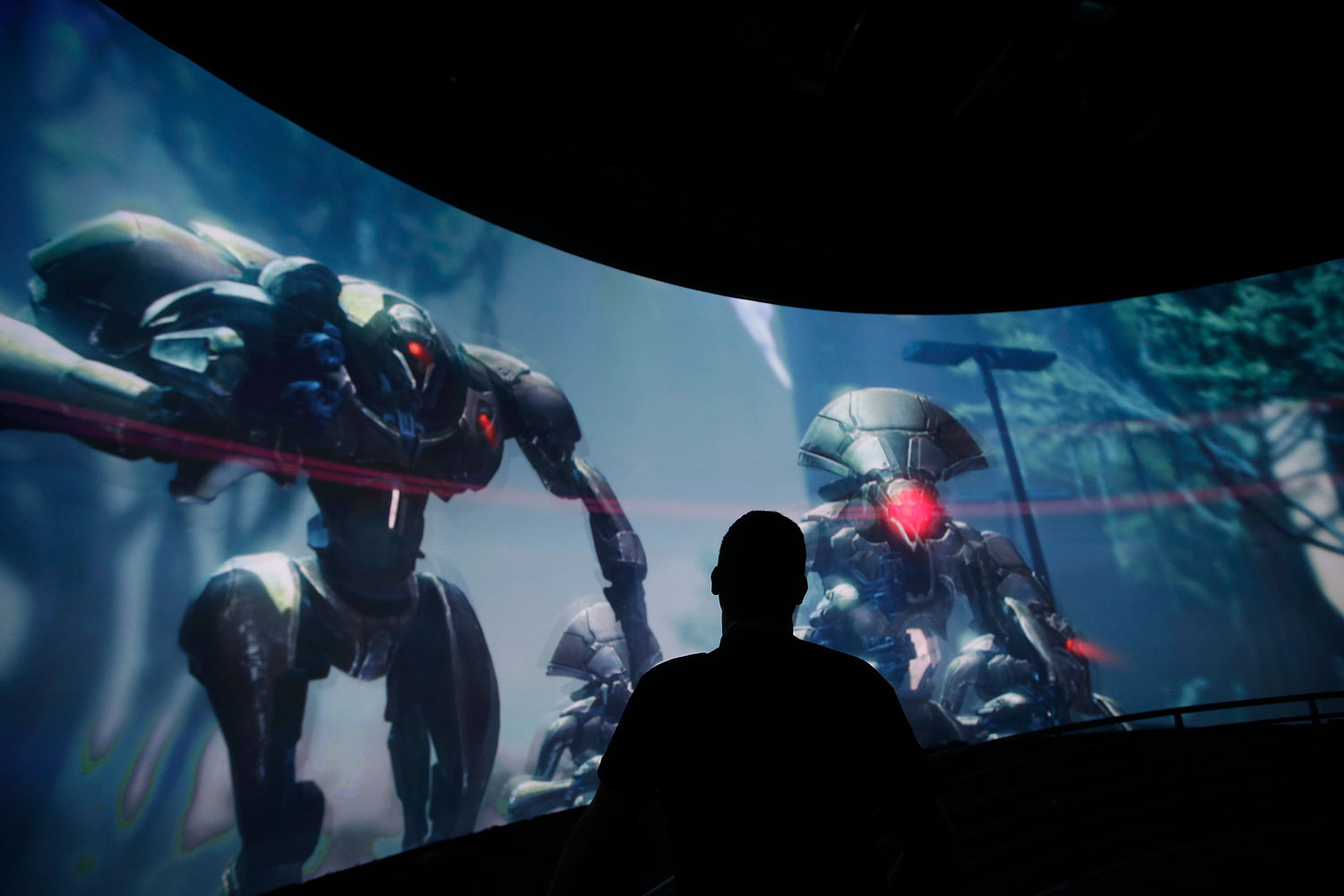 FILE - In this June 13, 2013 file photo, Alex Beckers watches a presentation on the video game  Destiny  at the Activision Blizzard Booth during the Electronic Entertainment Expo in Los Angeles, June 13, 2013.