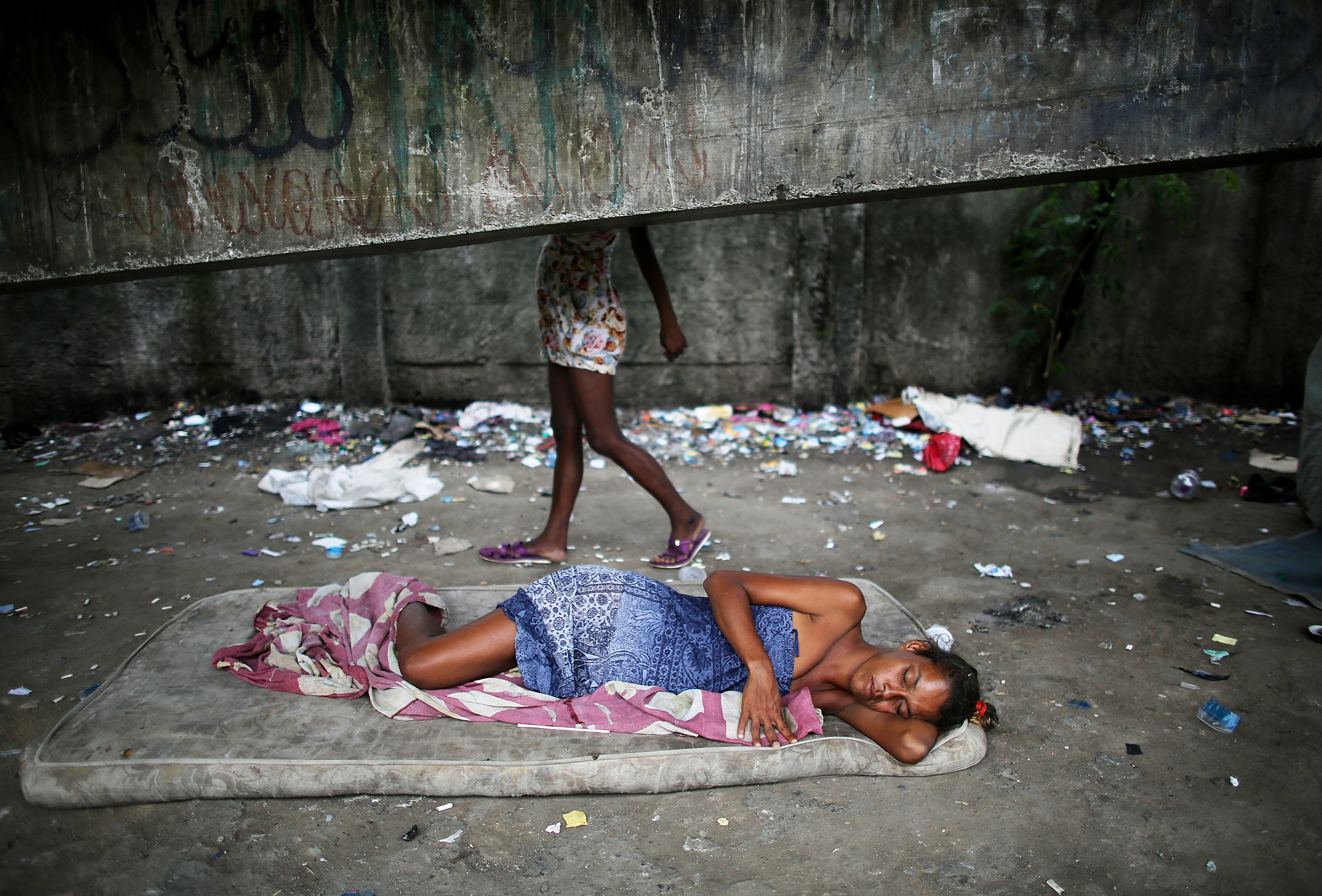 Drug users gather beneath an overpass in an area known as 'Cracolandia', or Crackland, in the Antares shantytown on December 10, 2013 in Rio de Janeiro, Brazil.