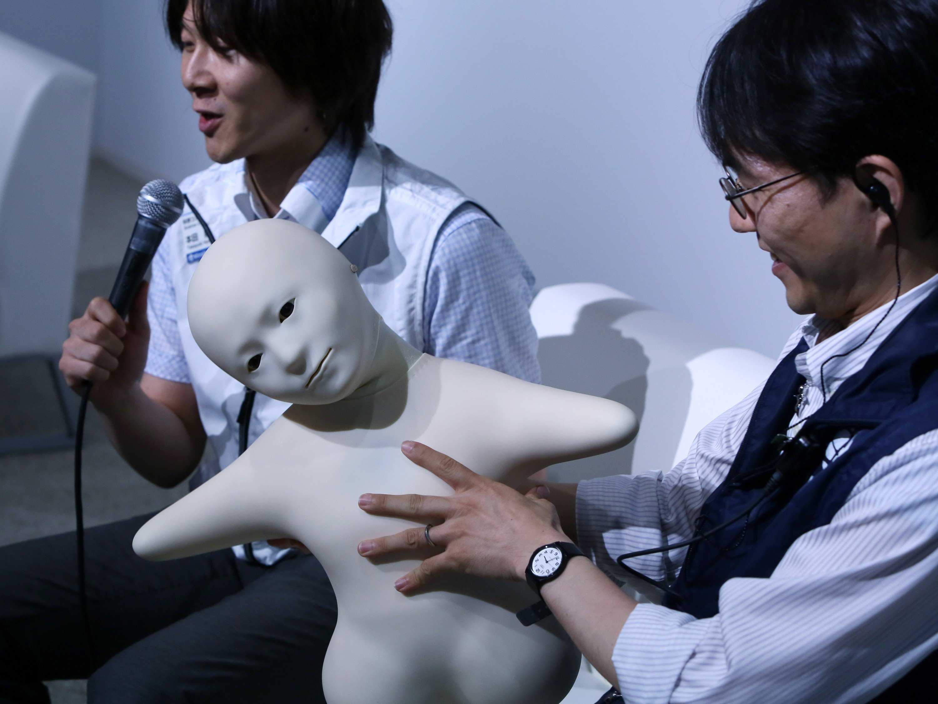 Telenoid is a teleoperated android robot with a minimal design, created as an attempt to embody the minimum physical requirements for humanlike communication during a press preview at the National Museum of Emerging Science and Innovation Miraikan in Tokyo on June 24, 2014.