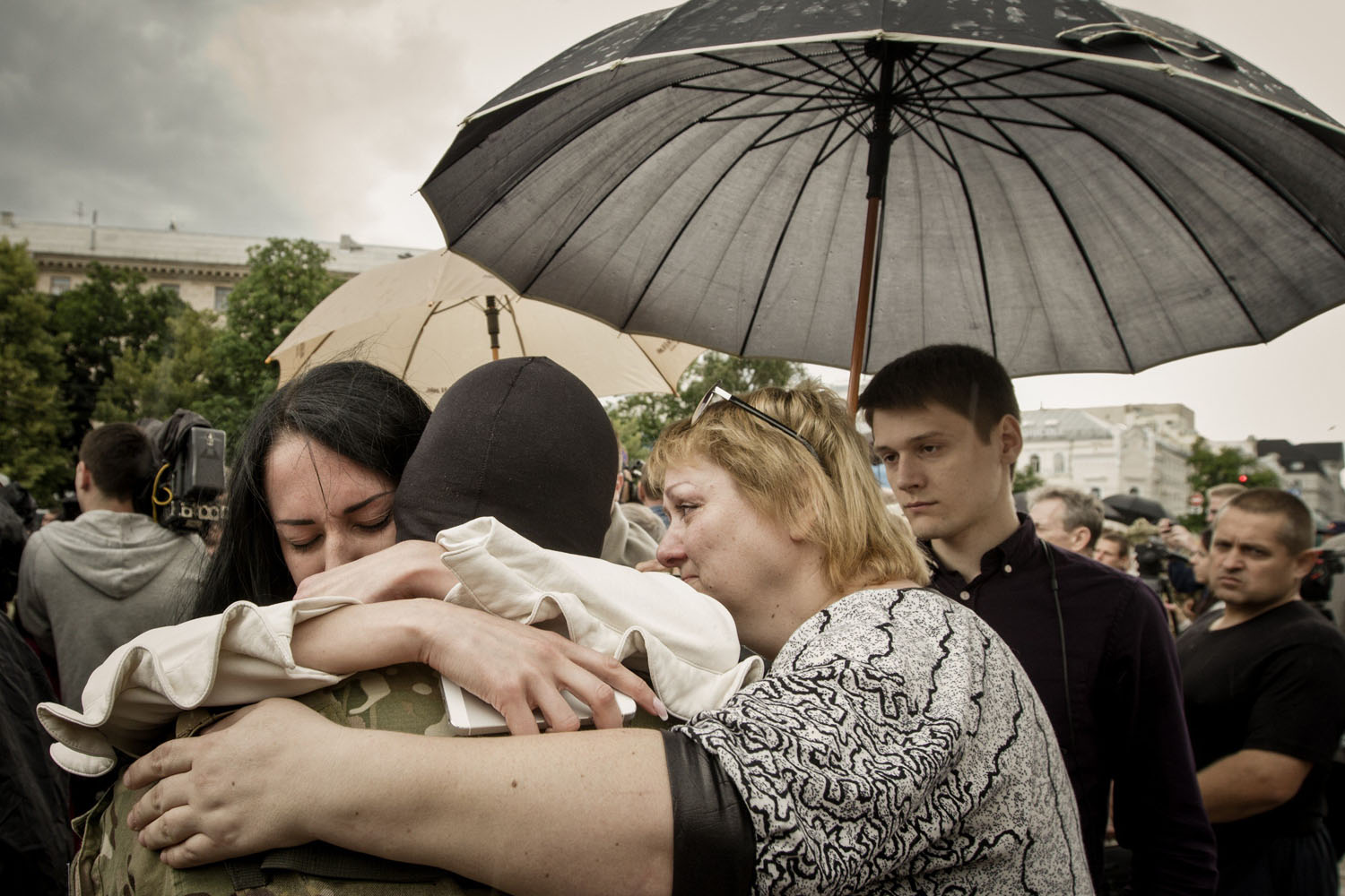 Jun. 23, 2014. Crying women hug a combatant who will take part in the military operation against armed pro-Russian militants in the east of the country and help end the uprising.