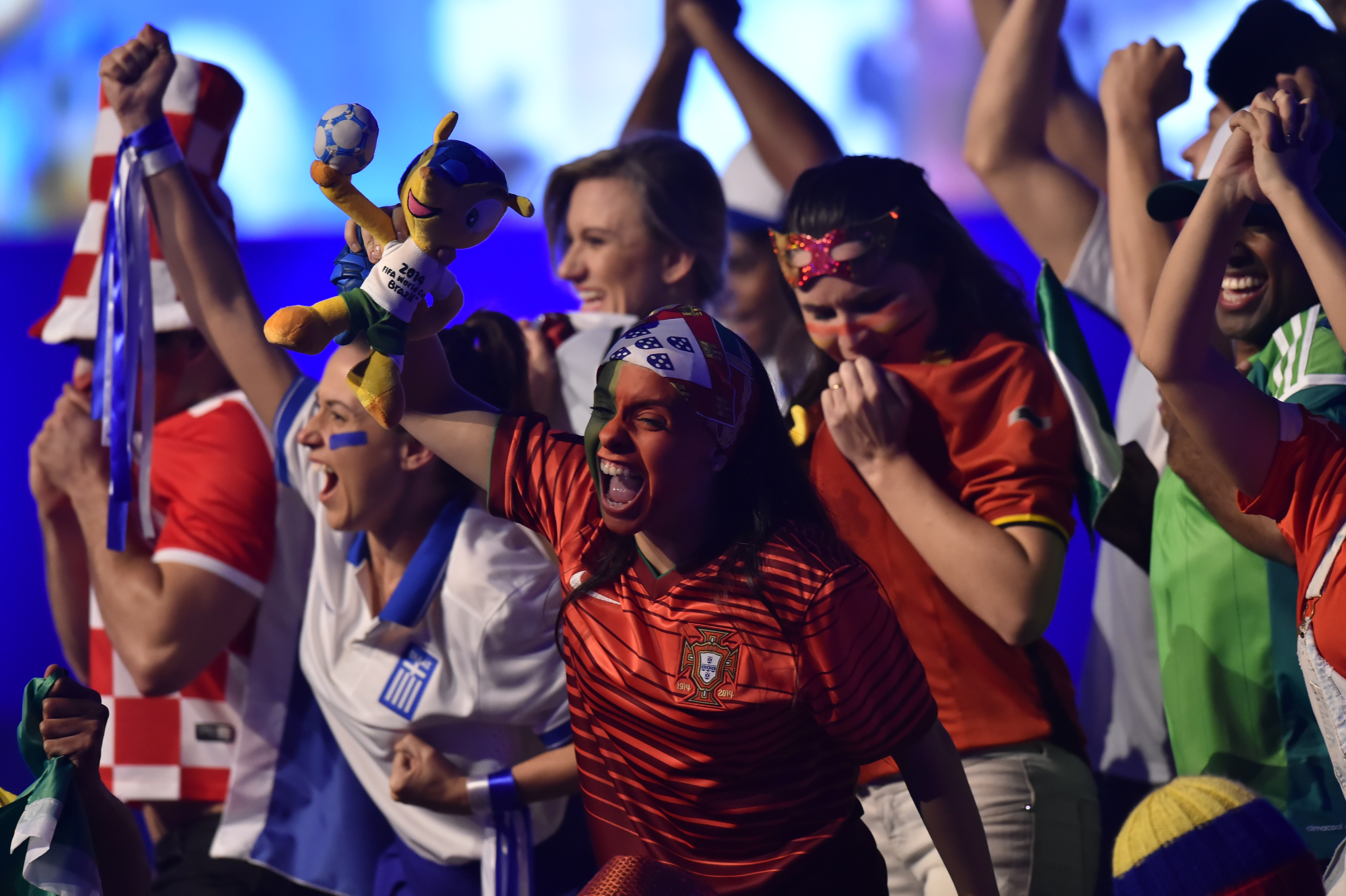 Performers dressed as football fans dance on stage during the opening of the FIFA Congress in Sao Paulo on June 10, 2014, two days before the opening match of the 2014 FIFA World Cup in Brazil.