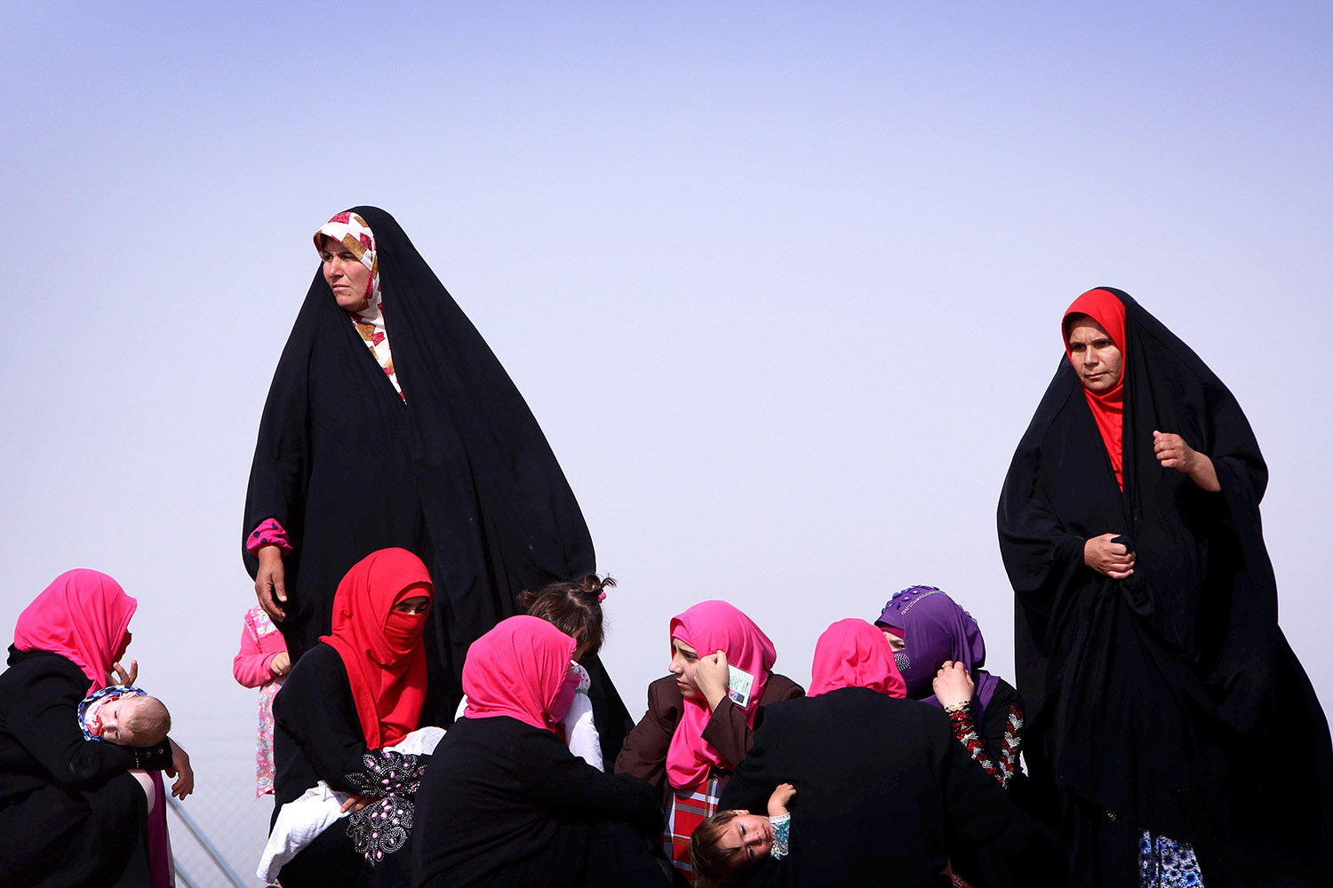 June 13, 2014. Iraqi women gather at a temporary camp set up to shelter civilians fleeing violence in Mosul.