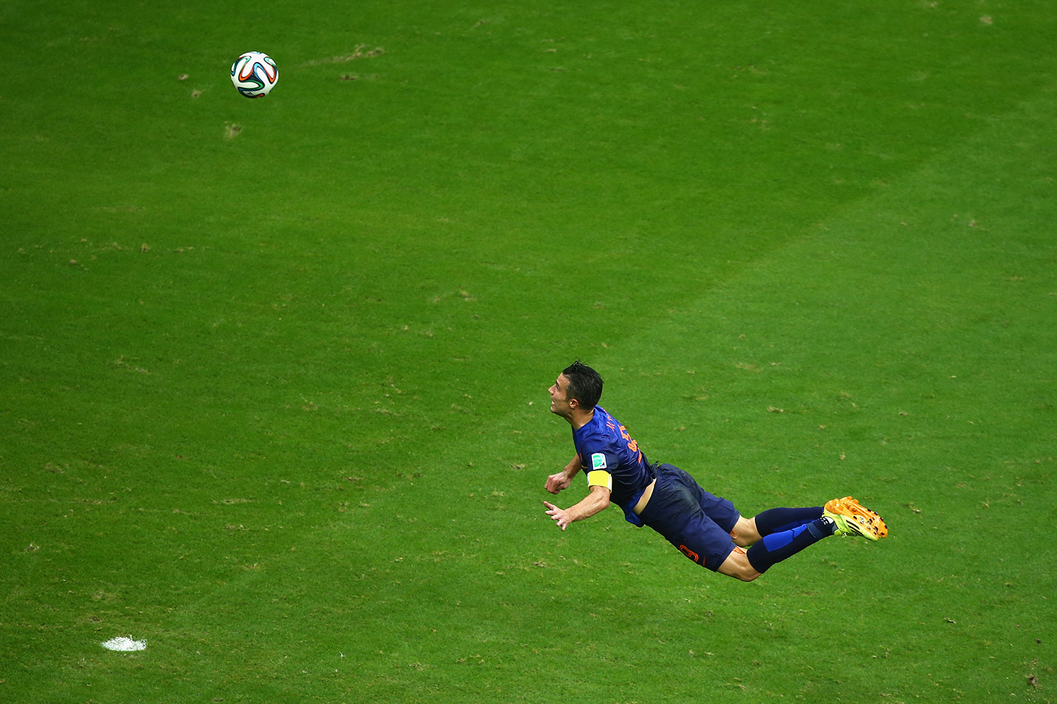 June 13, 2014. Robin van Persie of the Netherlands scores the teams first goal with a diving header in the first half during the 2014 FIFA World Cup Brazil Group B match between Spain and Netherlands at Arena Fonte Nova on in Salvador, Brazil.